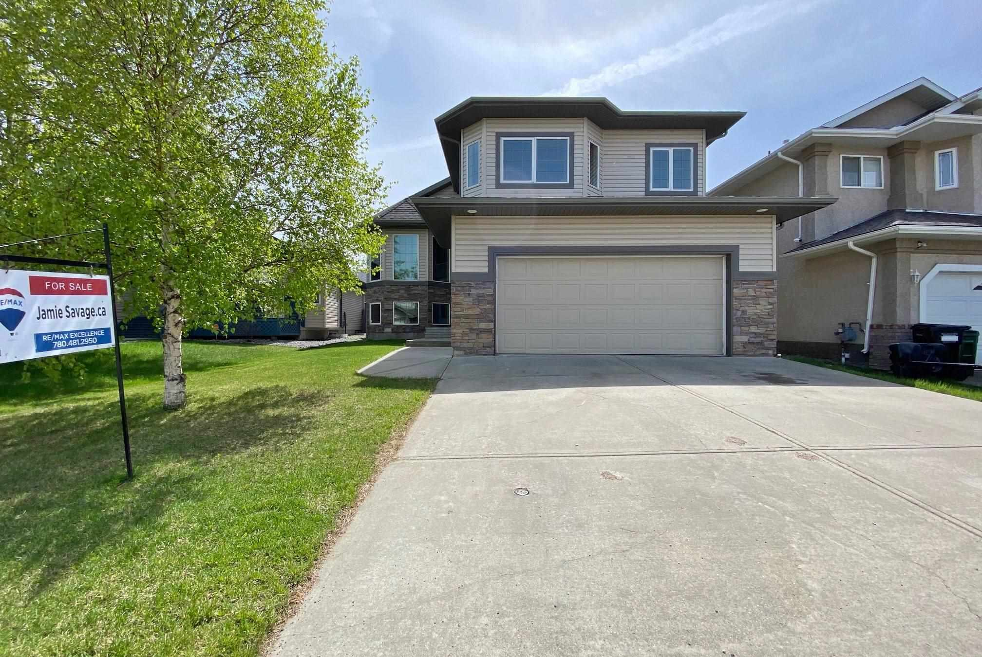 Your search is over! Welcome to this stunning 1,800 sq ft executive Bi-Level in the sought-after community of Chambery. Highlighted by the vaulted ceilings & big windows, the main level feels bright & open. The kitchen feat a large center island w/ granite counters, maple cabinets, corner pantry, s/s appliances & gas stove. Cozy up to the beautiful stone FP in the spacious LR. Off the large breakfast nook is the huge maintenance free vinyl deck w/ a large covered eating area. Two good sized bedrooms, a laundry room & a 4 pc bath round out the main. Above the oversized Double Garage is the amazing master retreat that incl a large walk-in closet & lux ensuite w/ steam shower. The fully finished basement features 9ft ceilings, a large rec room w/ corner gas fireplace, another 4 pc bath, plus two more bedrooms! Other upgrades incl: custom wood shutters, built in speakers on the main & theatre system rough-in in the basement. Walking distance to parks, playgrounds & public transportation. This is the one!