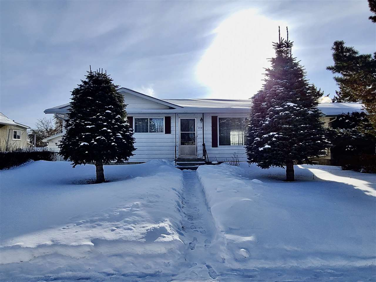 """""""Cute & Cozy""""  This charming bungalow has tons of potential.  It has three bedrooms, a 4 pc. bathroom  & a spacious living room.  The basement is unfinished & awaiting your creative side to complete it.  There is back alley access & plenty of room to build a garage or man cave."""