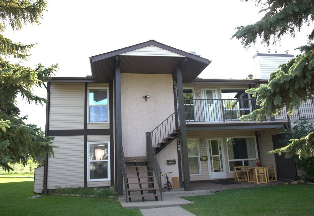 Nearby to Blackmud Ravine hiking/biking trails, this top floor end unit has extra windows for lots of natural light. Large north facing main bdrm & 2nd bdrm both have walk-in closets. French doors on 3rd bdrm could make it useful as a den. Catch the evening sun with the large maintenance free west facing deck with storage shed. Kitchen features large walk-in pantry & opens to a generous sized dining/living rm with cozy 2 sided wood burning fireplace. Easy access washer & dryer in this no smoking/no animal home. This quiet professionally managed pet friendly complex has recently replaced the roof, stairs, siding, railings and windows & is a short walk/drive to Century Park LRT, YMCA, schools, shopping & playgrounds. Easy access to a green space for your kids to play & the parking stall is on end directly in front of the unit. Condo fees include snow removal from your deck & steps, exterior maintenance & landscape. Carpets will be professionally steam cleaned. No yard but  large deck with gas hookup for BBQ