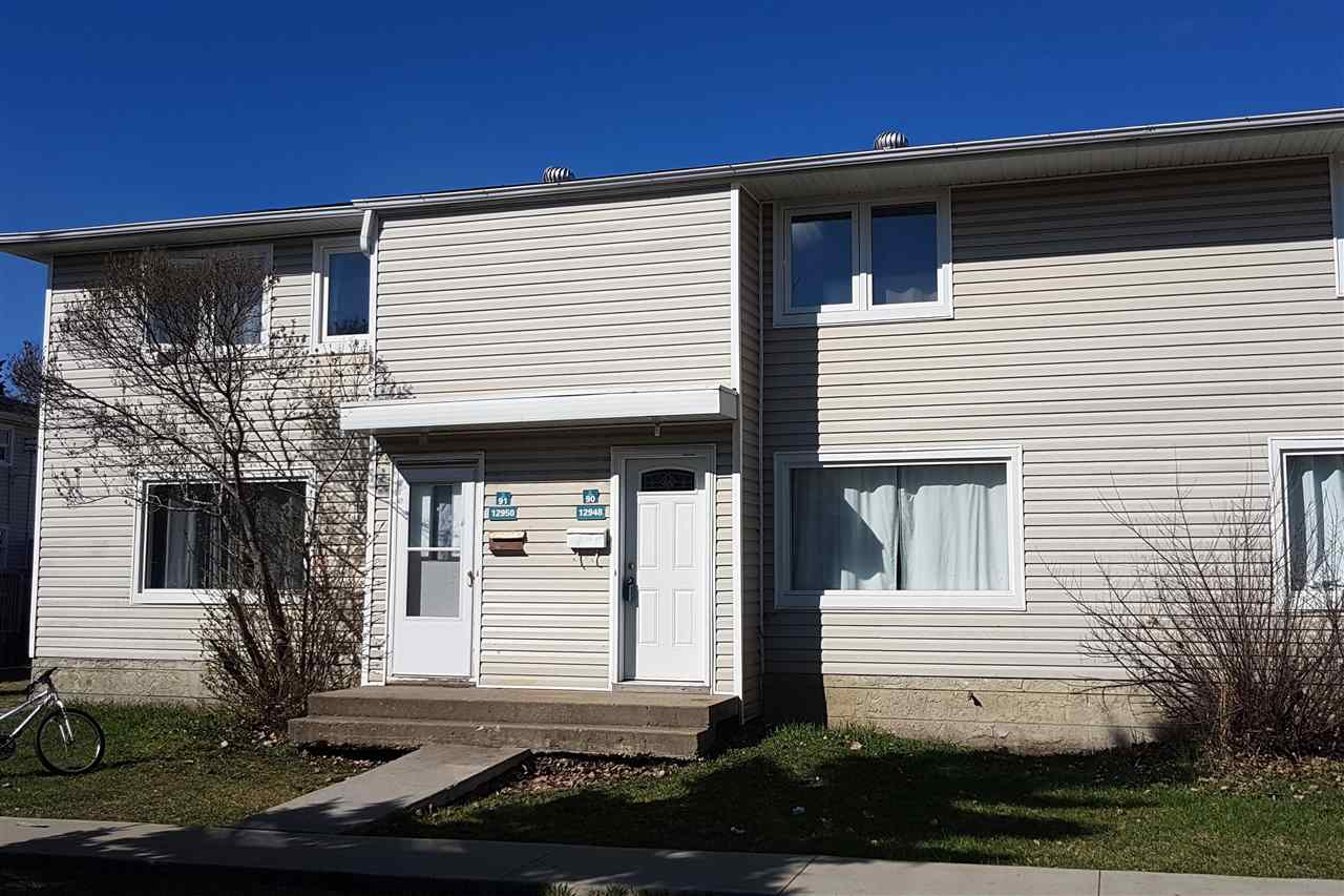 Condo fees are extremely low, below $100!  This affordable townhome is steps away from the highly ranked Aurora Charter Public School.  Great starter home or investment.  Upgrades to this home over the years include: white kitchen with stone backsplash, renovated bathroom, laminate flooring, newer shingles, newer hot water tank, windows, exterior doors, and there is also a sump pump in the unfinished basement.  Master bedroom is extra large with his and her closets and lots of room for a king sized bed.  There is also a sunny west facing deck plus parking stall.  Convenient location with easy access to St Albert Trail, Yellowhead Freeway and downtown.  Very few condo units come up for sale in this complex, buy now and take advantage of the low monthly payments this home offers! Payments including mortgage, property tax and condo fees could be as low as $867 per month with today's low interest rates.