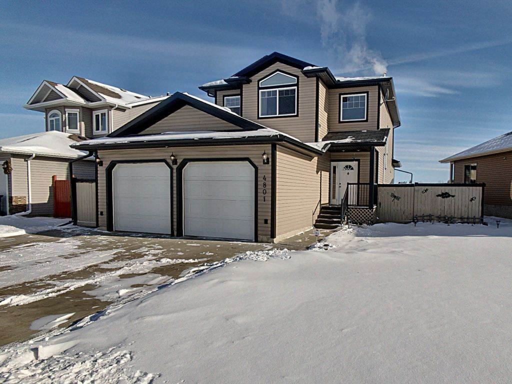 Beautiful well maintained home in the West Woodlands neighbourhood of family friendly Bruderheim less than 15 minutes to the plants in Fort Saskatchewan or 40 mins to the Henday in Edmonton. This gem backs on to a green space with walking trails and a playground nearby too. The fully finished home includes: A/C, open concept main living area with upgraded appliances, main floor laundry, fully finished basement, 5 bedrooms (3+2), 3 full bathrooms + a 2pc powder room on the main floor, jetted tub & separate shower in the ensuite, extra wide driveway to park 3 (room for an RV), oversized heated garage with workbench / wired for 220V / H & C water taps / floor drain / 2 overhead doors. Outside has 2 decks, an awning for the main deck, a playhouse with swings, a large shed & fire pit.