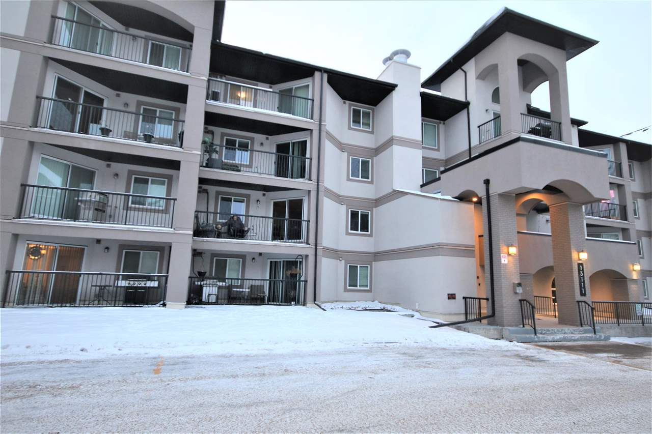 Spacious 2 bedroom, 2 bathroom condo unit faces the court yard. Upgrades include laminate flooring and crown molding in living room. The unit comes with an underground parking stall and a storage space. It's very conveniently located with walking distance to shopping and public transportation.
