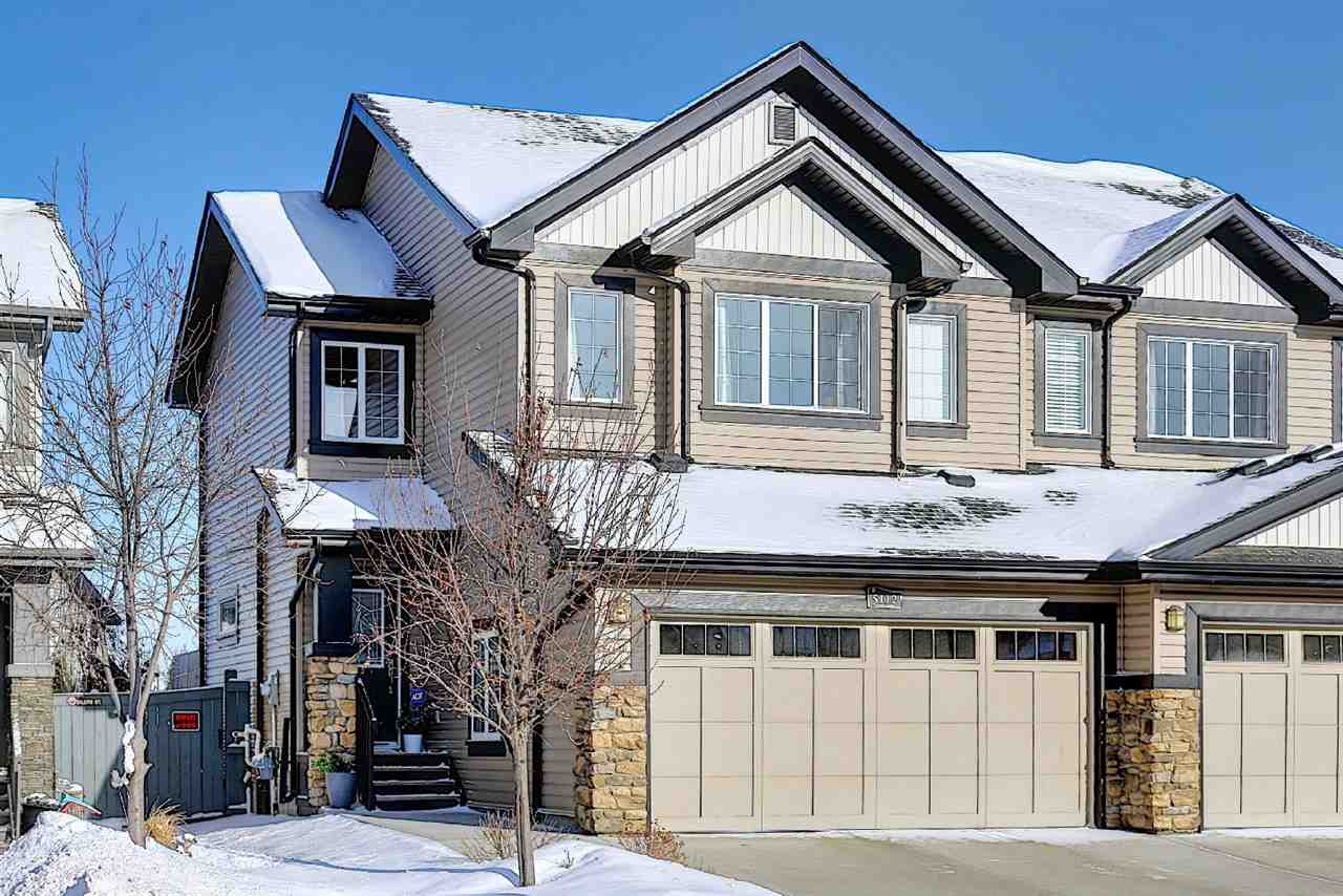 Absolutely immaculate, show home condition. 1363 sq ft on two levels. Main level has hardwood floor. Large kitchen island with stone countertops. Ample dining and living room. Stone tile backsplash. Very bright, modern and warm atmosphere. Gas f/p and 2pce bath on main. Laundry on main level. Upper level has large master bdrm with walk in closet and 4pce ensuite. Two more good sized bedrooms and additional 4pce bath. The basement is full and open waiting to be finished to buyers likes.  Double attached garage has a central floor drain, is insulated, drywalled and painted. Deck off rear. Fully fenced yard. Walking trail at rear. Close to all amenities. Non smoking, no pet home. A must to view!!