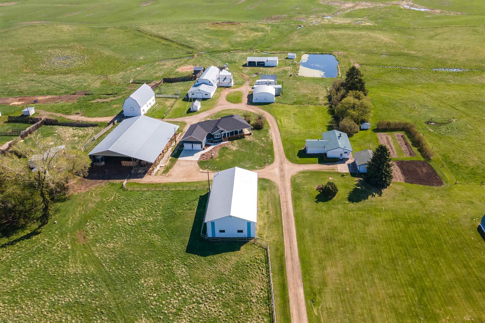 Imagine, 160 acres (2 separately titled 80 acre parcels) in the City of Edmonton, with 2 lovely residences, numerous shops & barns, gated & fenced & cross fenced that runs from 34 Street East to 17 street, one mile wide by 1/2 mile deep. Possibilities are endless. This land has been tentatively zoned future residential by the City of Edmonton. Approximately 55 acres in hay & the balance in pasture with maternity pens in the barn. A family homestead, the original barn was built in 1900, there is a 40'x80' shop with underslab heat & 20'x14' OH door, 50'x100' Quonset with dirt floor (cold storage), 2 barns 100'x40' & 70'x25' plus numerous other well maintained buildings. Offering 3000 sq. ft. of development in the (2020 built) gorgeous 'Modern Farmhouse' bungalow featuring underslab heat, 4 beds, 3 baths, AC & an attached garage. The 2nd. home is an immaculate 1467 developed bungalow, has had an addition & major renos & offers 4 beds & 2 baths & a detached double garage.  2 wells, a 3200 gal. cistern & more!