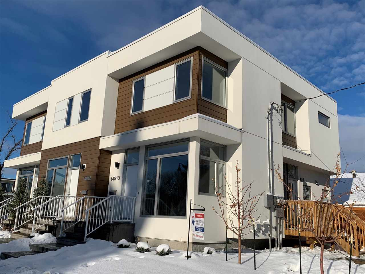 Quality Affordable Living in Crestwood! Well situated, this two-storey row house is located just 12 minutes from downtown with quick access to NAIT, Grant MacEwan, 124th St, Kingsway and WEM. Brought to you by TRITONE INC., this 4 bedroom/3.5 bath row house is built to exceptional standards. The main floor boasts a comfortable living room with an electric LED fireplace, as well as floor to ceiling windows showcasing an abundance of natural light. There is a modern kitchen with granite countertops and stainless steel appliances, a dining area connecting onto the patio, and a half bath and laundry to complete the main floor. The second floor includes a master bedroom with full ensuite and generous closet space, two additional bedrooms and full bath. The basement includes a family room, spacious bedroom and full bath. Each unit has its own detached garage, and the property is professionally landscaped with fencing and privacy screens
