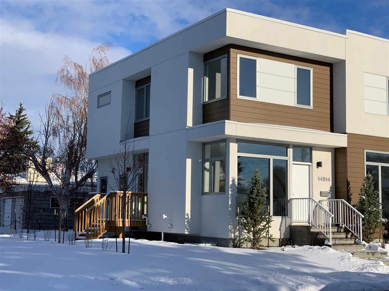 Quality Affordable Living in Crestwood! Well situated, this two-storey row house is located just 12 minutes from downtown with quick access to NAIT, Grant MacEwan, 124th St, Kingsway and WEM. Brought to you by TRITONE INC, this 4 bedroom/3.5 bath row house is built to exceptional standards. The main floor boasts a comfortable living room with an electric LED fireplace, as well as floor to ceiling windows showcasing an abundance of natural light. There is a modern kitchen with granite countertops and stainless steel appliances, a dining area connecting onto the patio, and a half bath and laundry to complete the main floor. The second floor includes a master bedroom with full ensuite and generous closet space, two additional bedrooms and full bath. The basement includes a family room, spacious bedroom and full bath. Each unit has its own detached garage, and the property is professionally landscaped with fencing and privacy screens