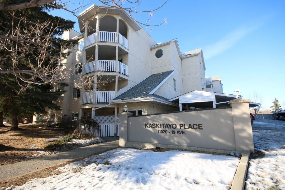 Welcome to Kaskitayo Place, a PROFESSIONALLY MANAGED 4-floor condominium complex built in 1989 & located in the Keheewin community. Only 5 minutes from the LRT, public transportation, YMCA, U of A, shopping, the Anthony Henday & Kaskitayo Park! You will love this main floor, 1149 sq ft south-east corner unit with its soothing soft paint décor, white interior doors & trim & newer viny plank flooring! Offers: good-sized entry w/ mirrored front closet & additional storage closet, in-suite laundry, 3-piece main bathroom, living room w/ wood-burning fireplace, guest bedroom & spacious master w/ dual closets & 4-piece jacuzzi ensuite. Kitchen has ample light-colored cabinetry & room for a good-sized table in the dining area. Sliding door access to your concrete patio. Secure storage unit just down the hallway & one covered/energized parking stall. Pets are allowed w/ board approval & guest parking. Immaculate & ready for quick possession!