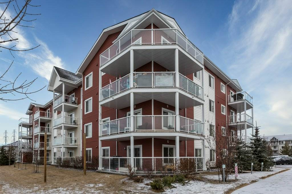"""This gorgeous condo is situated in the sought after 'Aspen Meadows"""" complex. You will enjoy a light open floor plan, 2 good sized bedrooms, open kitchen with granite countertops, stainless steel appliances and island, dining area and large living room. This corner unit offers a wrap around balcony facing both North and East giving beautiful natural light! The master bedroom enjoys a walk in closet with a 3-piece ensuite, the second bedroom has an adjacent 4-piece bathroom. Unit comes with 1 underground and 1 above ground parking stall. Walking distance to 17th Street means close access to public transportation, shopping, banking facilities, coffee shops, restaurants & walking distance to grocery stores. This unit can be yours!"""