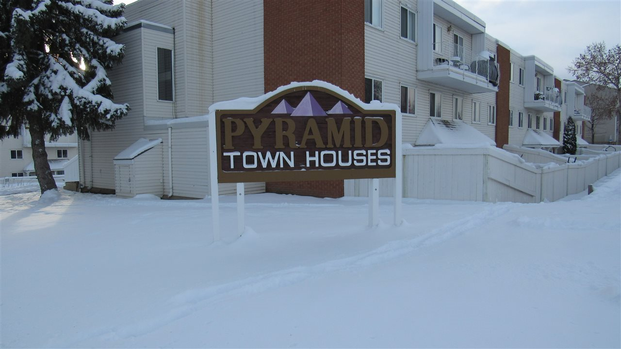 Beautiful 3-bedroom townhouse in the multilevel apartment complex of Pyramid Estates. This bright, updated unit has it all! The spacious main floor includes a huge living room, dining area, a good size kitchen, and a laundry room. Upper floor has a large primary bedroom with a big walk-in closet and a half ensuite, two more good-size bedrooms, a big storage/computer room, and a 4-piece bathroom. Nice laminate flooring throughout, and beautiful ceramic tiles in kitchen, dining and bathrooms. Newer kitchen, BATHs and modern-color paint. The complex has undergone major renovations in the last ten years, including roof, boiler, fence, pavements, windows, doors, hallway carpets and parking plug-ins. Best of all, condo fees INCLUDE HEAT, WATER AND SEWER! This is a perfect unit for first time buyers and won't last!
