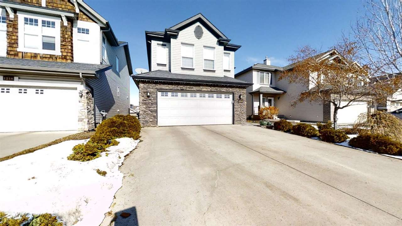 Live in one of Edmonton's most desirable neighborhoods! The home is located on a quiet street steps to the park, pond/waterfalls & ravine trails. This Landmark home features 4 bedrooms and 3.5 baths, a beautifully landscaped yard, and double over sized garage. The kitchen boasts ceramic backsplash, under cabinet lighting, walk-in corner pantry, stainless steel appliances including gas stove, and island overlooking the great room with gas fireplace. Open floor plan, large windows and great view of the private back yard. On the second floor is a large, bright bonus room with 9-foot ceiling, a master bedroom with spa-like ensuite and walk-in closet, two more large bedrooms, and full bath. Finished basement has 4th bedroom/den, family room, office/exercise area, full bath and storage. Added bonuses, triple pane windows, security system, Kinetico water system & central vac. Walk to shops, restaurants, Terwillegar rec centre, and schools. Great access to Henday and other major routes.