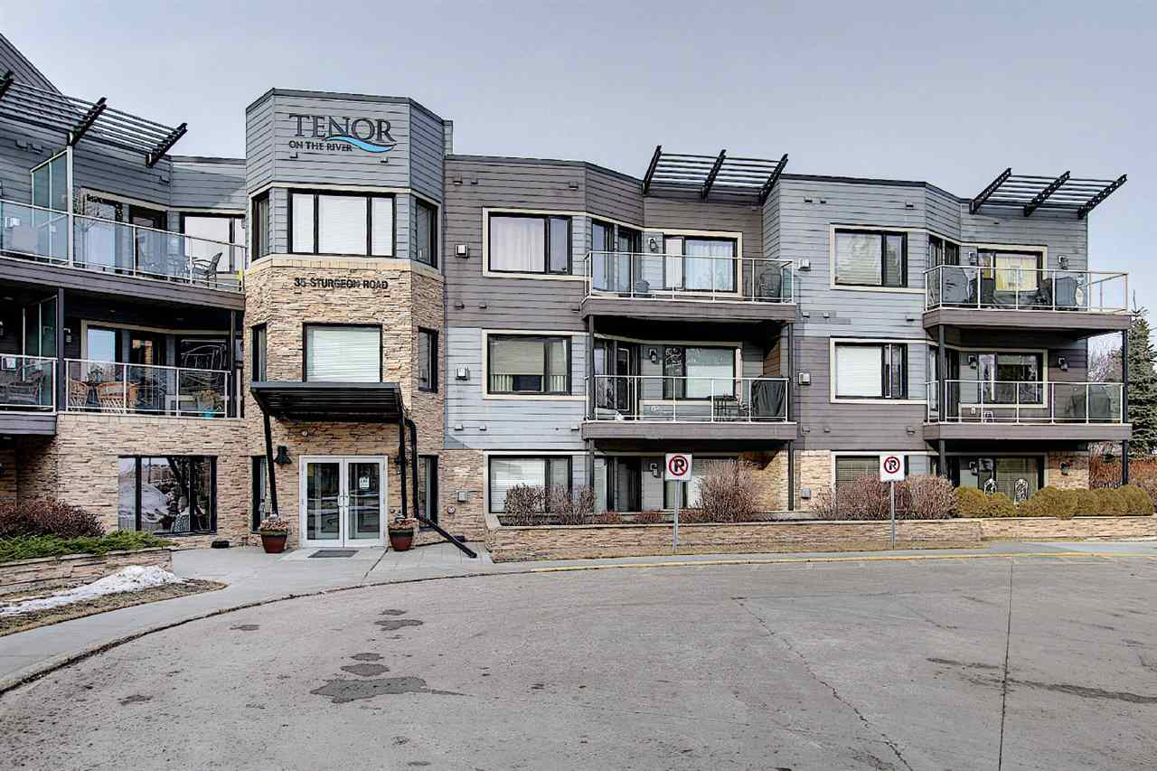 Welcome to this LUXURY 1 bedroom condo with 2 titled heated underground parking stalls, situated on a bank of the Sturgeon River in the hear of St. Albert with excellence River view! Enjoy the VIEWS of the STURGEON RIVER VALLE with the Southwest facing balcony & bbq during summer! Features open concept floor plan with large living room, bright windows, cozy corner gas fireplace with ceramic tile surrounding, 9 feet ceilings, gorgeous laminate floorings adjacent to spacious kitchen. Peninsula kitchen offers modern cabinets & stainless steel fridge, stove, hood fan & dishwasher. Master bedroom comes with 4pc en-suite & closet.  In-suite laundry.  2 titled underground parking stalls & storage locker. This is a STEEL & CONCRETE Construction building with unparalleled value and build quality offers gym room & party room. Great location with only steps to river, parks, restaurants, public transportation and all amenities! Quick possession available. Just move-in & enjoy!