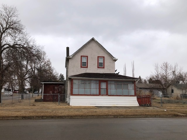 This property has an old 2 storey home on it however it is given zero value.  The value is in the lot.  The lot is landscaped and completely fenced with chain link fencing. Beautiful corner lot.