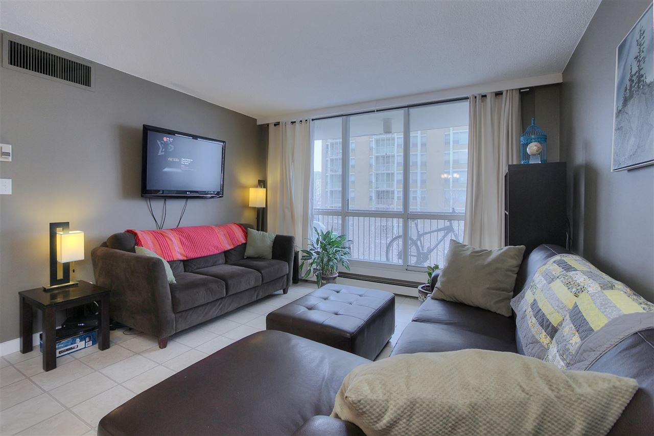 Location, location, location!  This affordable condo is located in the perfect spot!  In the heart of the city, minutes from Jasper Ave, LRT, & the River Valley.  The bright two bedroom corner unit is in the high rise concrete building, Hillside Estates. With a comfortable west facing living room & balcony, spacious dining room with a west & north exposure. The fully updated kitchen features white cabinets, modern lighting & full sized appliances. The master bedroom offers a west view & large closet, the 2nd bedroom is also very well proportioned with a large closet. The suite also boasts an upgraded 4 pc bath with a fully tiled surround and floor. A large insuite storage room. The building amenities includes pool, gym with his and hers sauna, games room and a fully furnished guest suite.  This secure building is ideal for students or professionals or anyone who wants to be downtown but still be on a quiet tree-lined street. Bay/Enterprise Square LRT station is minutes away.