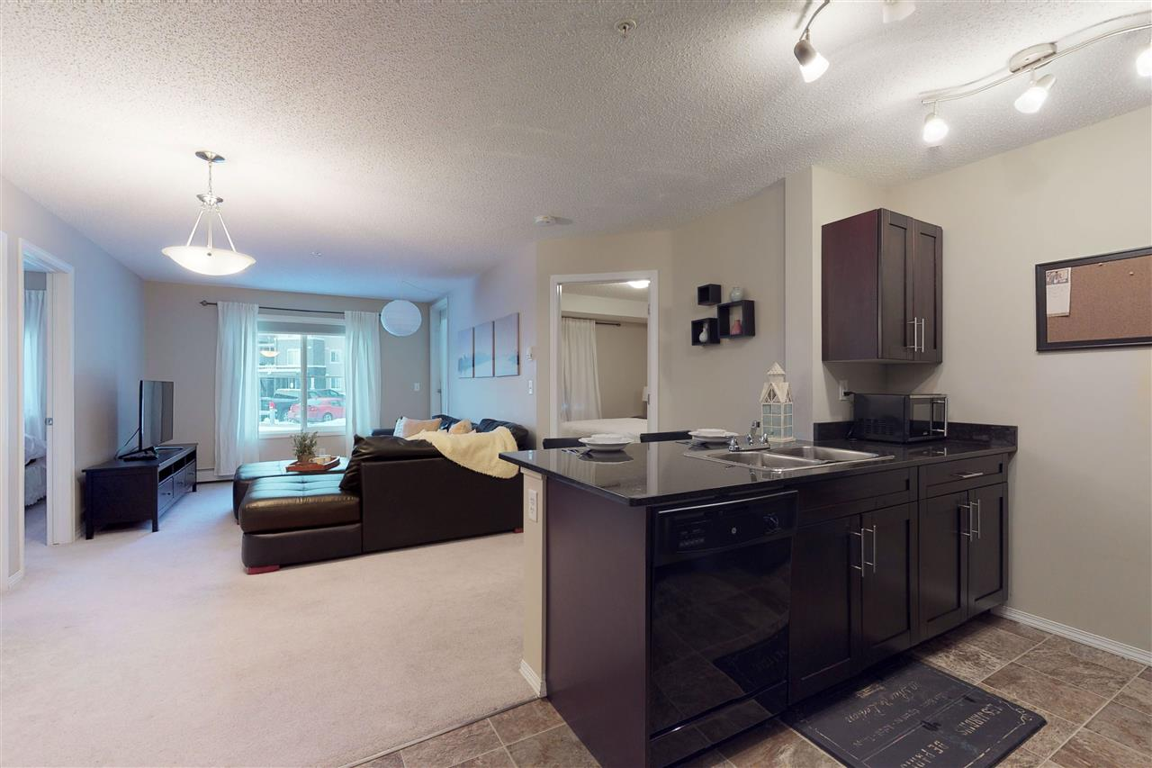 Welcome to Pet Friendly Walker Lake Landing in the community of Walker. This open concept unit boosts lots of natural light, and offers comfortable and convenient living. The open concept kitchen features beautiful granite countertops, lots of cabinetry & counter space for cooking. Just opposite the kitchen is a bonus room or den great for an office or dinning room. The large living room is spacious & great for entertaining with the large patio doors & access to your own private patio area & BBQ hookup. The master bedroom features a large closet & ensuite. The main bathroom has an upgraded soaker tub & beautiful tile surround. The large second bedroom is spacious has a nice sized closet.The in-suite laundry is convenient & with the outdoor parking stall right outside the unit there is no need to walk through the building with your shopping bags. Shopping & schools nearby & quick access to airport, Henday & South Ed-Common. Unit can be sold fully furnished.