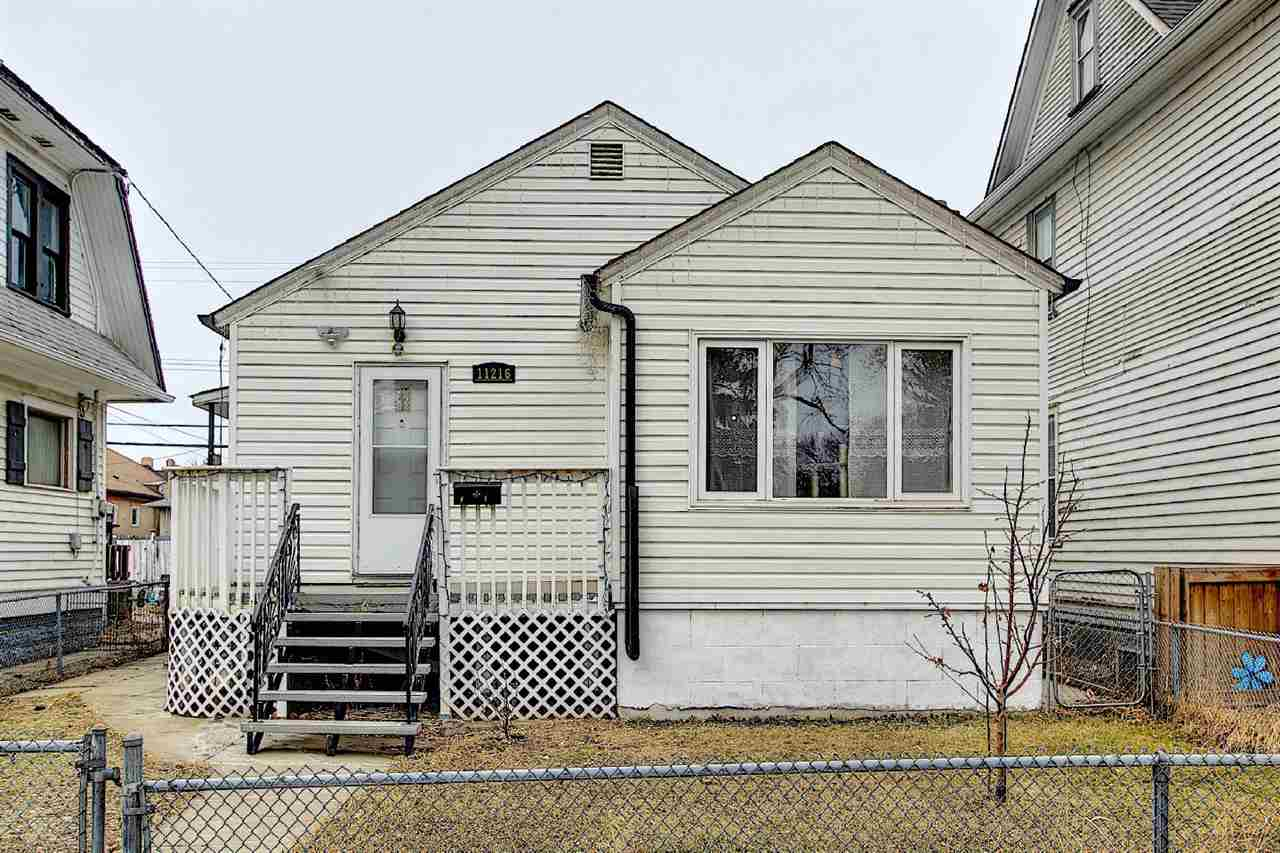 Why rent? own this low affordable, stunning bungalow situated in the convenient location with only minutes to Downtown/Grant MacEwan University/Nait/Kingsway Garden Mall/Chinatown/Italy centre & all amenities. Features total of 2 bathrooms/4 bedrooms/den room/living room & family room. Main floor greets you with large living room with bright windows/nice laminate floorings adjacent to dining area. Spacious kitchen with newer appliances. 2 good-sized bedrooms both with laminate floorings. 4pc bath room. Side door entrance to fully finished basement comes with 2 additional bedrooms/computer room & great room all with laminate floorings throughout. Fully bathroom & laundry area. Carpet free home!  Upgrades in last 10 years: shingles/vinyl siding/vinyl windows/laminate floorings in living room & dining room/light fixtures/100 amp electrical panel/bathroom vanity & tiles. Back yard with extension concrete & back lane to single detached garage. Ready move-in condition. Just move-in & enjoy!