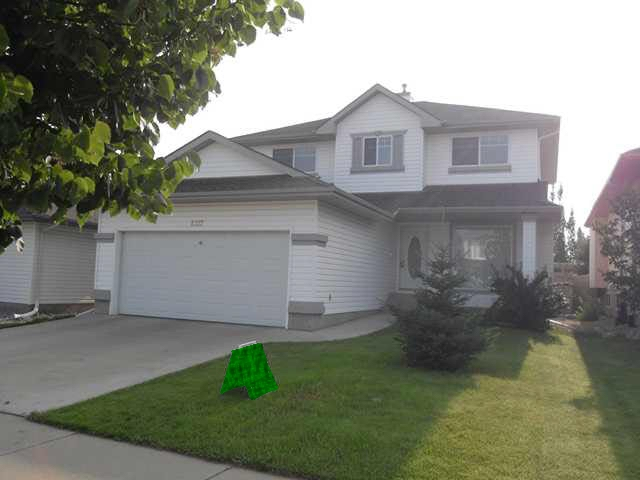 WOW!!! LAYOUT & LOCATION ... 1/2 BLK to the RAVINE on this Twin Brooks 3 bedroom 2 story with State of the art NEW CUSTOM WALNUT kitchen features both GRANITE and QUARTZ countertops, Undermount lighting PLUS MARBLE FLOORING... walk through pantry with gorgeous BUTLERS KITCHEN, with 2nd fridge and a ton of pantry, cupboard & storage that leads straight into the SUNNY laundry room.. finishing the main level are GORGEOUS SOLID OLIVE HARDWOOD floors.... 20 foot cathedral ceiling in the living room.. master bedroom has a large walk-in closet and a five piece en-suite bath. A good sized fenced yard with a private deck with gasline .....BRAND NEW SHINGLES... QUIET LOCATION and more!!