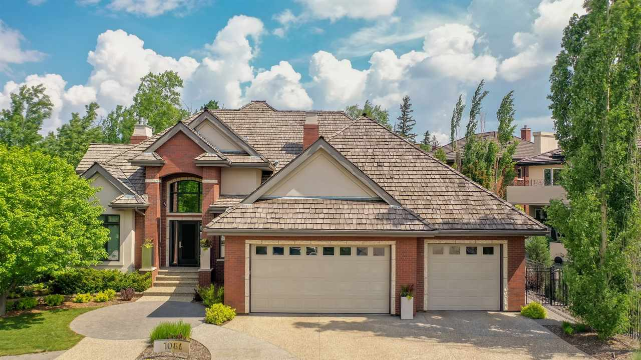 STUNNING RAVINE LOCATION - Wolf Willow Ridge Estates. This beautiful custom bungalow home is situated on a 9819sqft stunningly landscaped walk-out ravine lot. Over 3353sqft plus a fully finished walkout basement ? totalling over 5427sqft of luxury & well designed living space. The home showcases 2 bedrooms on the main floor ? spacious master suite; walk-in closet & lavish spa like ensuite bathroom, 2nd bedroom includes a walk-in closet - plus 3 beds in the basement, 6 bathrooms (3 powder rooms, jack/jill bathroom & 2 ensuites), a chef?s kitchen (custom cabinetry, high end appliances), formal dining room, butler pantry, spacious loft/bonus room overlooking the ravine, 3 fireplaces, theatre room, wine cellar, spacious entertaining spaces inside & outside.  The owners have carefully selected finishings throughout the home blending the warmth of traditional living with modern elements. Full house sound system (12 room Nuvo), in-floor heating in the kitchen, bathrooms, basement & in the triple attached garage.