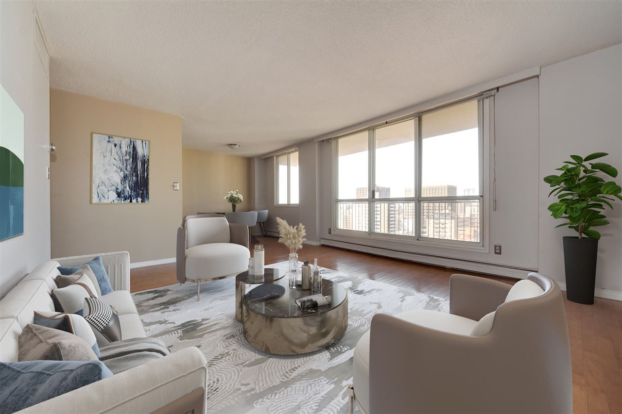 Amazing opportunity for investors. Large west/north-facing two bedroom end unit with two bathrooms in the heart of downtown. Nearly 1000 sq ft on trendy 104th st, steps from the river valley, local businesses and restaurants. Large windows throughout fill the unit with natural light. Primary bedroom boasts a large walk-through closet on the way to a private 2pc ensuite. Easy to clean hardwood flooring and ceramic tile throughout. Enjoy some fresh air on your enormous unit-wide, west facing balcony. Parking and utilities included (except cable/internet). Property sold on an as-is, where is basis.