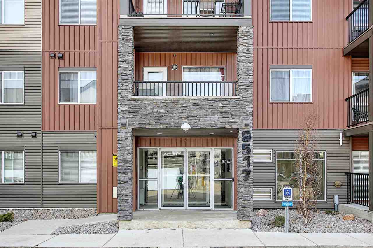 Excellent location! Excellent value! This  stunning END UNIT condo offers 2 bedrooms, 2 bathrooms, an underground heated parking stall & a surface parking stall. Features open concept floor plan, neutral color living room is brightened with a large window and large balcony access with gas line hook up for summer BBQ. Spacious kitchen with modern kitchen cabinets, quazt counter tops, matching kitchen island for dining and stainless steel appliances! Master bedroom comes with walk-through closet and 3pc en-suite bathroom. Additional bathroom & 2nd bedroom has bright window. In-suite laundry room. Only steps to Eaux Claires transit station, LRT, park, playground, restaurants, shopping & all amenities! Easy access to 97 St and Anthony Henday drive. Come & check this out and make this lovely place yours!