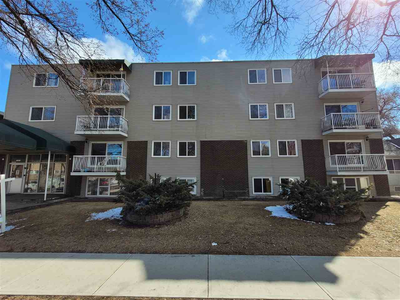 This centrally located condo in Queen Mary Park is an excellent fit for a first-time investor or buyer! This condo is within walking distance to MacEwan University, Metro Line LRT and only minutes away from the downtown core. It also provides easy access to the University of Alberta via public transit. The close proximity to Kingsway Mall, Rogers Place and fabulous downtown dining offers great convenience from day-to-day!  Very spacious 703 sq ft second floor unit with 1 large bedroom, 1 full bathroom and large living room overlooking the private balcony with newer triple pane windows and patio doors installed within the past few years. It is newly renovated with brand new laminate and vinyl flooring throughout the entire unit that provides for easy fuss-free cleaning and maintenance! The kitchen has new backsplash, countertops and provides ample cabinets. The new and modern-looking tub tile surround in the bathroom, abundant storage space and an assigned parking stall at the back of the building complet