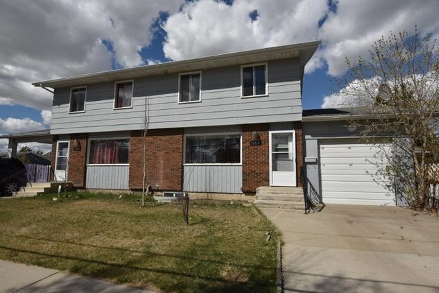 Great starter home or investment opportunity.  Quietly located in Canora neighborhood, next to a park, sports field and playground. This transitional community is experiencing plenty of new development.  1094 sqft half-duplex situated on a corner lot measuring 74 x 50. Brand new carpets throughout.  Developed basement: rumpus room, 4th bedroom, summer kitchen and 3-piece bathroom.  Single carport with overhead door.  Easy access to 149 St. leading up to Yellowhead Trail.  Just minutes to shopping, public transit, Royal Alex Hospital and downtown.