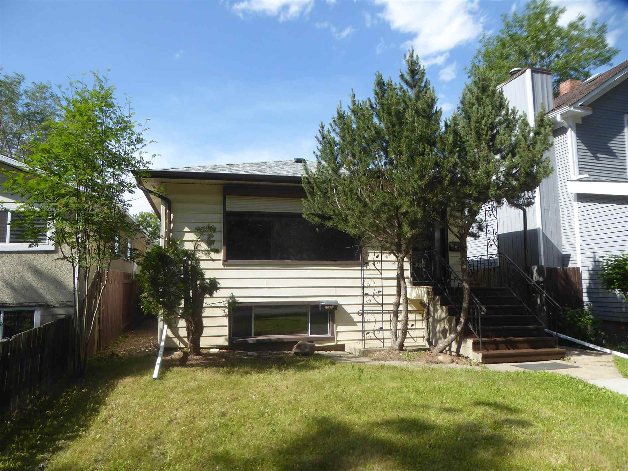"""Welcome to this spacious 1200' raised bungalow with two recently renovated """"in law"""" basement suites with separate entrances in a terrific low traffic cul de sac in Queen Alexandra!  The main floor features huge living and dining rooms, an eat in kitchen, a 4 pc main bath and 3 bedrooms.  The lower level with huge windows throughout has a private south entry that  leads to the front """"in law"""" suite of the basement with a kitchenette, living room, bedroom and 4 pc bath.  The side entrance has access to the north part of the basement that includes a newer kitchenette, living room, a  4 pc and a bedroom.  The furnace, hot water tank and washer and dryer are found in the common area.  The property is fenced and includes a large double detached garage. The house also has newer shingles.  Close to many great amenities of the south side including Queen Alex School, Strathcona Composite and Pool, the shops and cafes of Whyte Avenue and with easy access to the University of Alberta, it's a must to consider!"""