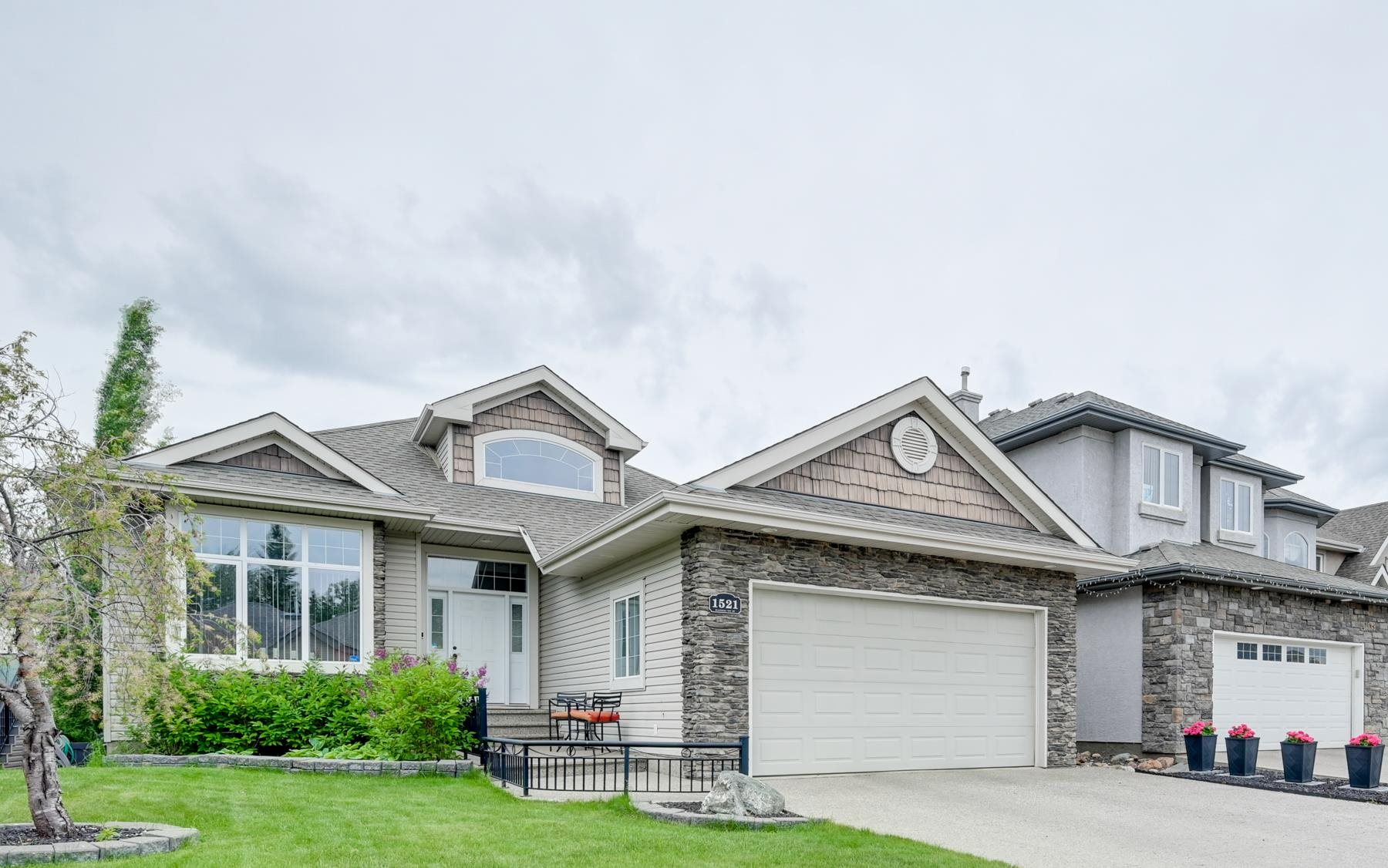 One look will do!! You will love this ONE OWNER open floor plan WALKOUT bungalow built by Camry Homes. Large foyer with curved staircase to lower level, main floor den/Bdrm and Maple hardwood throughout main floor. Bright and spacious living room with a gas fireplace. Kitchen features GRANITE countertops, eating bar, large nook with built in cabinets, and a walk through pantry to laundry with sink. Primary bedroom features a 5 pce ensuite. Enjoy the lower level with in floor heating, 2 spacious bedrooms, 4 pce bath, large family room to enjoy games night, workout area and  more! Other features include BRAND NEW A/C , gas line for BBQ on large upper low maintenance deck, oversized double garage with floor drain, newer furnace and HWT, NON SMOKING and PET FREE. Located close to all amenities. A must to see!!