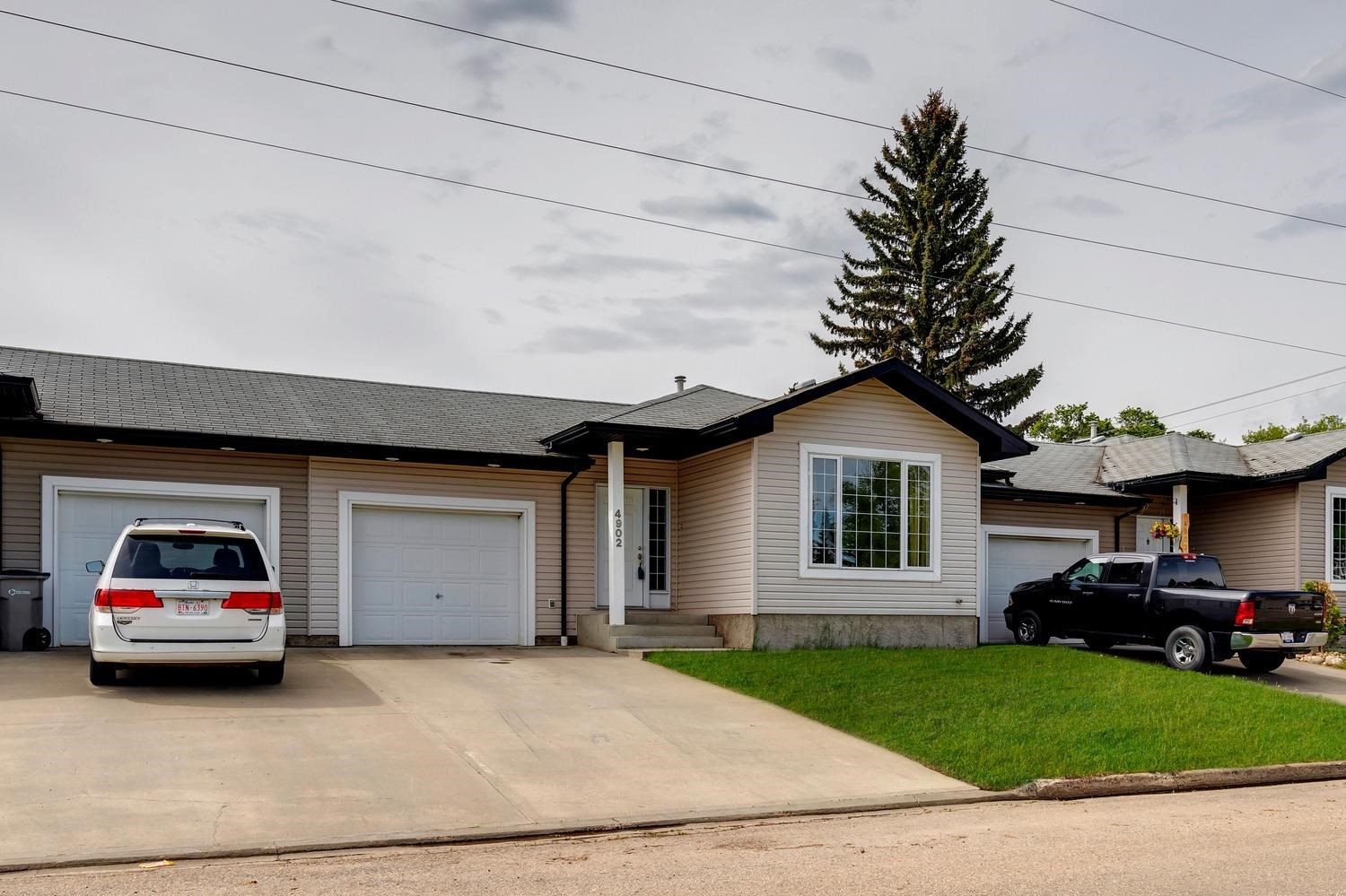 Terrific investment opportunity in Calmar. Nicely appointed tri-plex located across the street from a school/park area. This 1200 sqft bungalow offers 2+1 bedrooms, 3 full baths, 2nd kitchen/laundry in basement, and has been very well maintained. Bright and spacious main floor, open living area, good sized bedrooms, new main bath, 4-pc ensuite, and new appliances. Fully finished basement features good sized kitchen/living areas, huge bedroom, and 3-pc bath. Single attached garage, deck, fully fenced and landscaped. Perfect for an investor or mortgage helper.