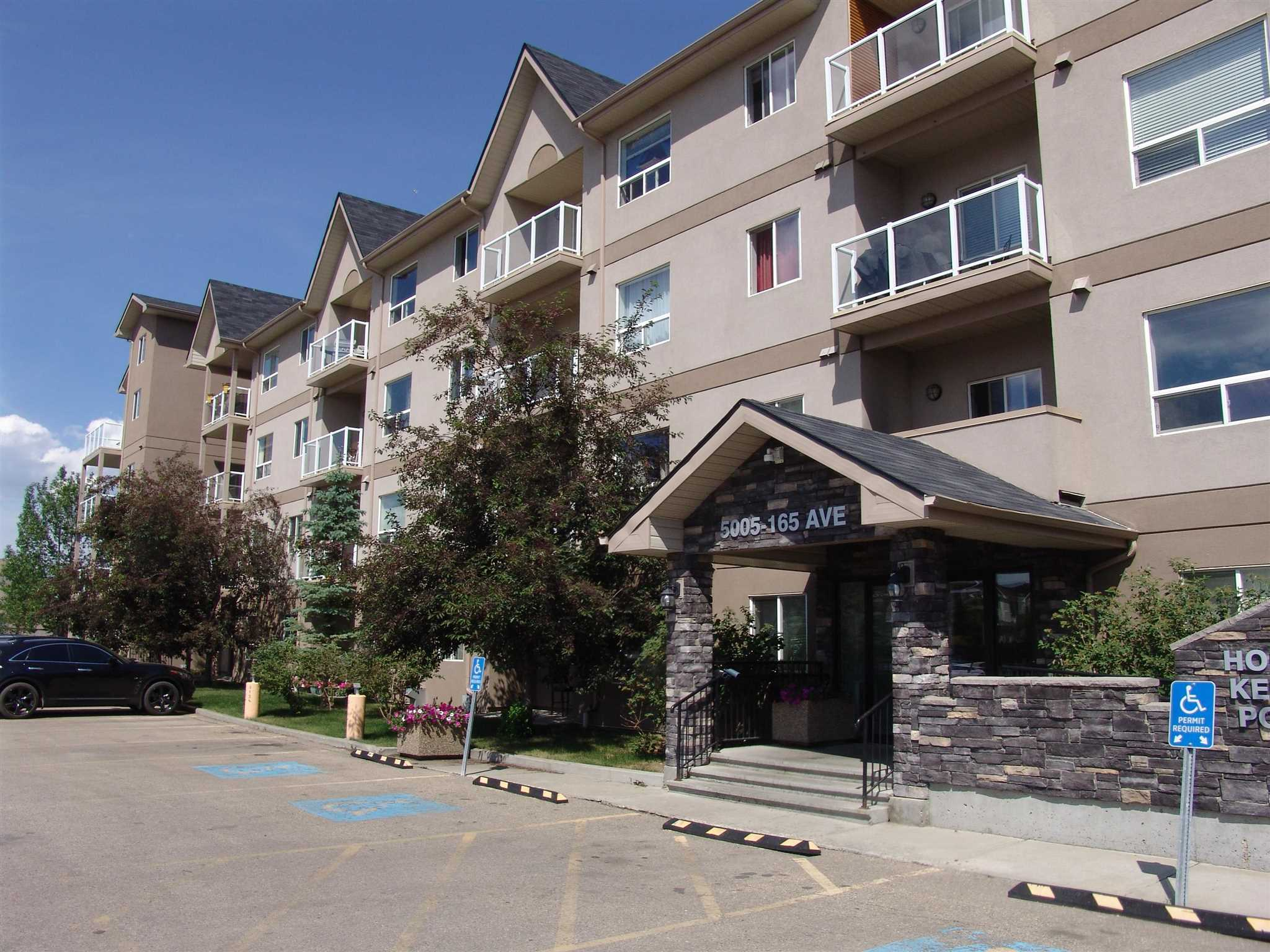 Beautiful & well-maintained apartment condo located in the well sought-after community of Hollick-Kenyon. This large, over 973 sq.ft. CORNER UNIT condo, with windows on 2 sides, features a great open floor plan, kitchen with loads of cupboard space & newer upgraded stainless steel appliances, gorgeous laminate flooring, a SEPARATE DINING area, large living room and insuite laundry with newer washer and dryer. Highly desirable corner unit with tons of natural sunlight!! 2 spacious bedrooms with the master having a large walk-in closet and 4-piece en-suite. As well, there is a 4-piece guest bath. Amenities include an exercise/weight room. Great location with schools, PARKS WITH WATER SPRAY & ICE RINKS, shopping, amenities and transit & HIGHWAYS. A great place to call home!!