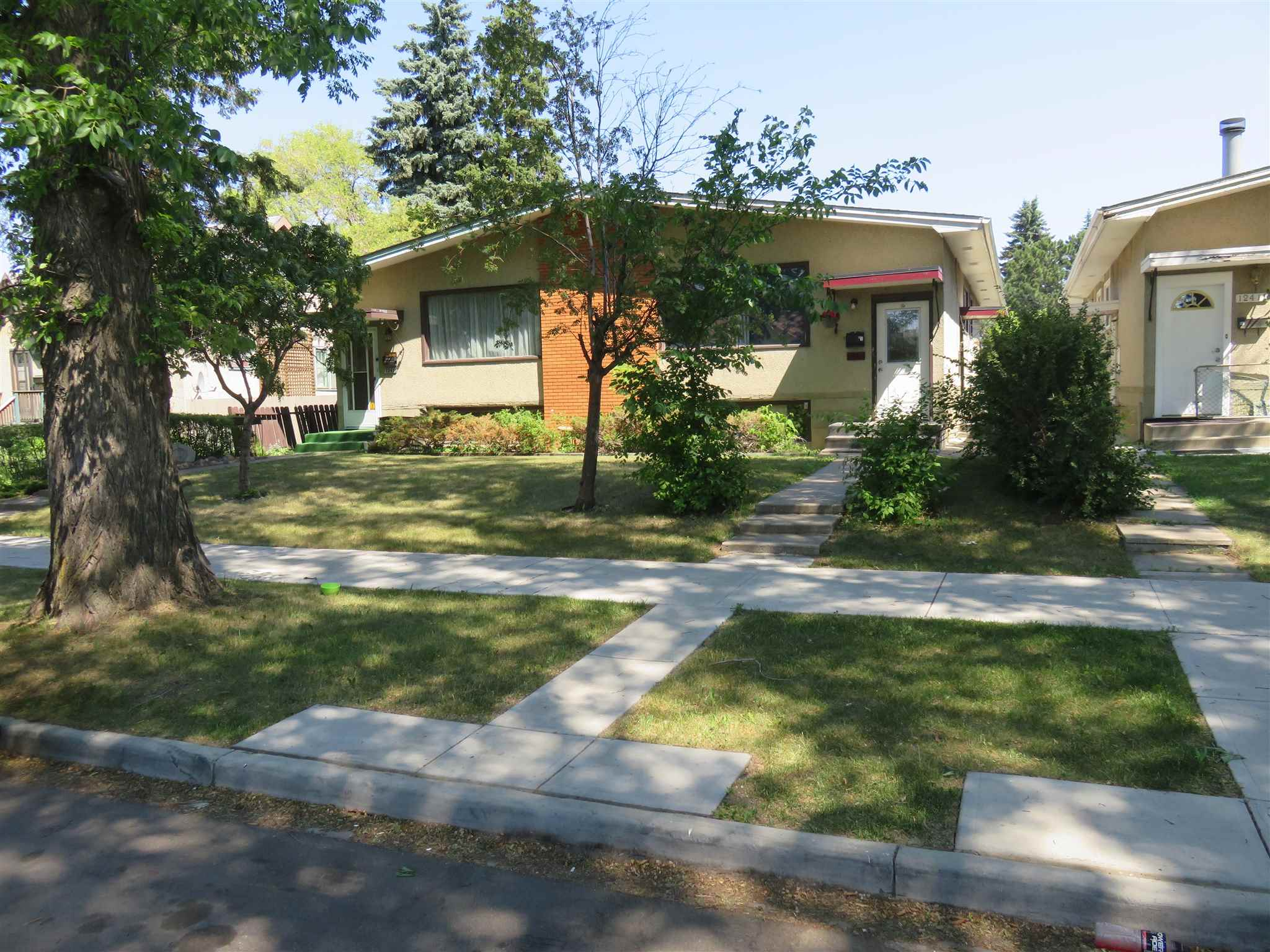 """GREAT INVESTMENT PROPERTY!!...F/F, 5Bdrms/2Full Baths, 2 KITCHENS, 2 LAUNDRY ROOMS, 1/2 DUPLEX w/well over 2000SQ.Ft of Living Space on a 3900Sq.Ft Lot with plenty of space to build an """"Income Garage too!"""" In the Community of """"PRINCE CHARLES!"""" Right off Yellowhead Trail & 127 Street. NW. All newer LAMINATE FLOORING on the main floor with carpet in all 3 Upper Bedrooms. Nice bright Kitchen w/a full 4pc Bathroom and main floor Laundry Room. The Basement has a Lg Family Room, Separate Kitchen, 2 Bedrooms, Full 4Pc Bathroom, A Separate Laundry Room & Plenty of Storage Area. Great quiet Street with K-9 Schools, Shopping, & a ETS Bus Stop a short walk from your front door. GREAT PROPERTY WITH $2300.00 AVAILABLE PER MONTH!!"""