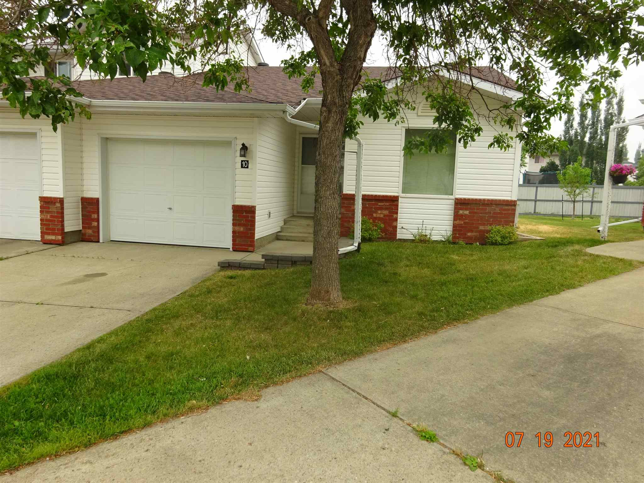 Nice Adult 2 BR bungalow with att'd garage and east exposure on the back. Spacious LR with laminate floors & a gas corner f/p. Light Oak kitchen with Fridge, stove, d/w, & hood fan - dinette adjoins kitchen & has laminate floors as well, Also has back door to yard.  Large MBR with 2 pc. bath and step in closet, 2nd BR is also a good size.  M/F laundry is in the hall closet on the way to garage entry to the house.  Basement is unfinished but it insulated and has roughed-in plumbing for another bath.  Mid efficient furnace and 10 yr. old h/w tank.  Roof has been reshingled.  There are carpets in both BR's.  New eaves troughs just installed July 23 & 24th.  Nice senior's type of floorplan.