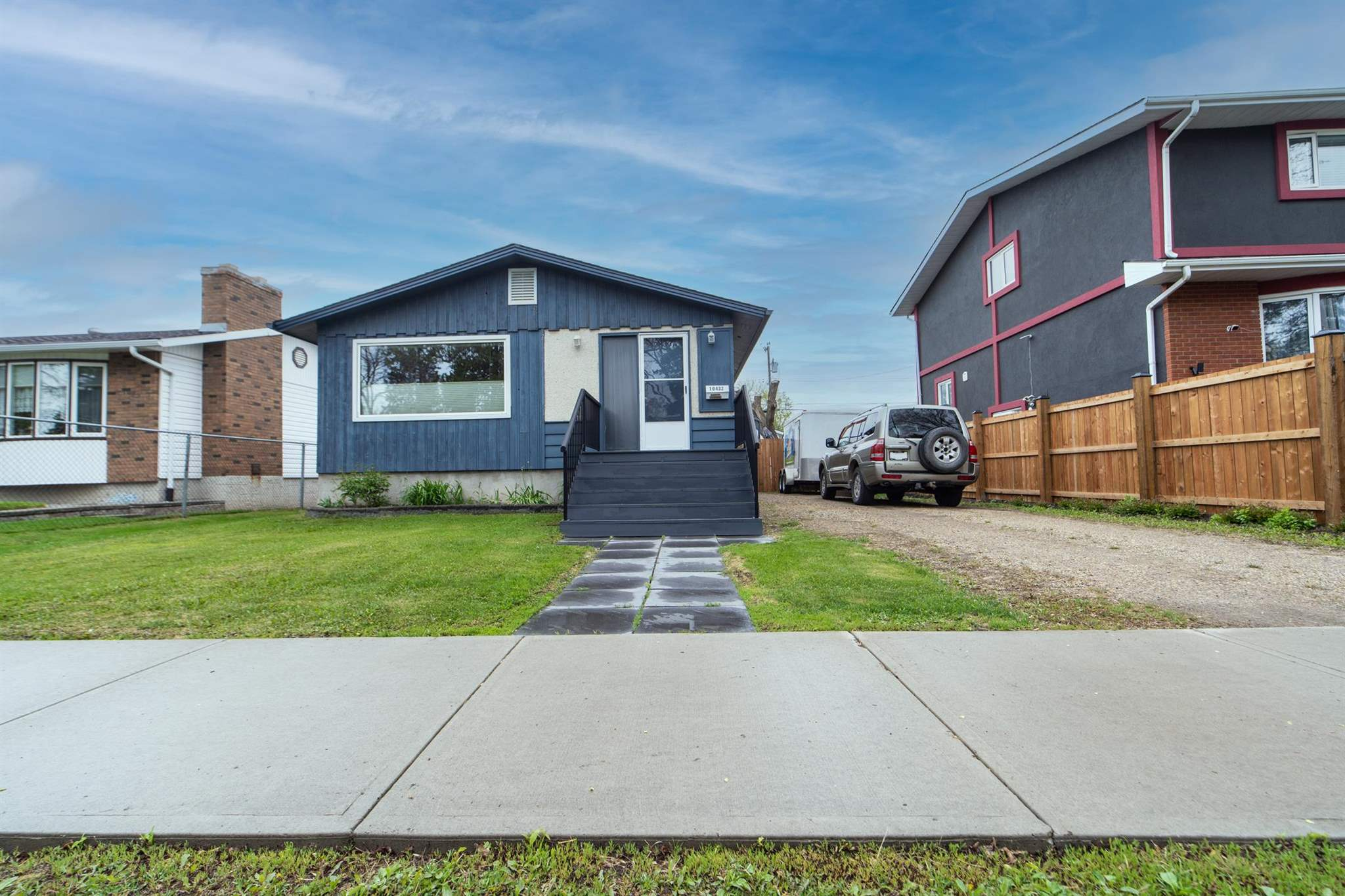 Extensive improvements supported by pride of ownership. This little gem has many great features that make it stand out. The home is nicely appointed and fully developed on both levels. A total of 3 bdrms & 2 full baths. The lower level is cozy and features it's own kitchen, family room, bdrm and 3pc bath. This space is separated from the upper level with it's own door at the base of landing. Flooring is a combination of hardwood & ceramic tile. Major improvements include roofing, some windows, sewer line, sump pump, hot water tank, fencing, concrete floor slab in garage, flooring & both bathrooms. The garage far exceeds that typically seen at this price level. At 24' wide x 26' deep it is oversized and will accommodate pretty much any size passenger vehicle. The interior ceiling height is 10' to underside of trusses; allowing for stacking of some vehicles on car hoists. The large 49.5' x 148' lot is ideal for garden lovers. Community hall across the street has a full size rink and basketball courts.