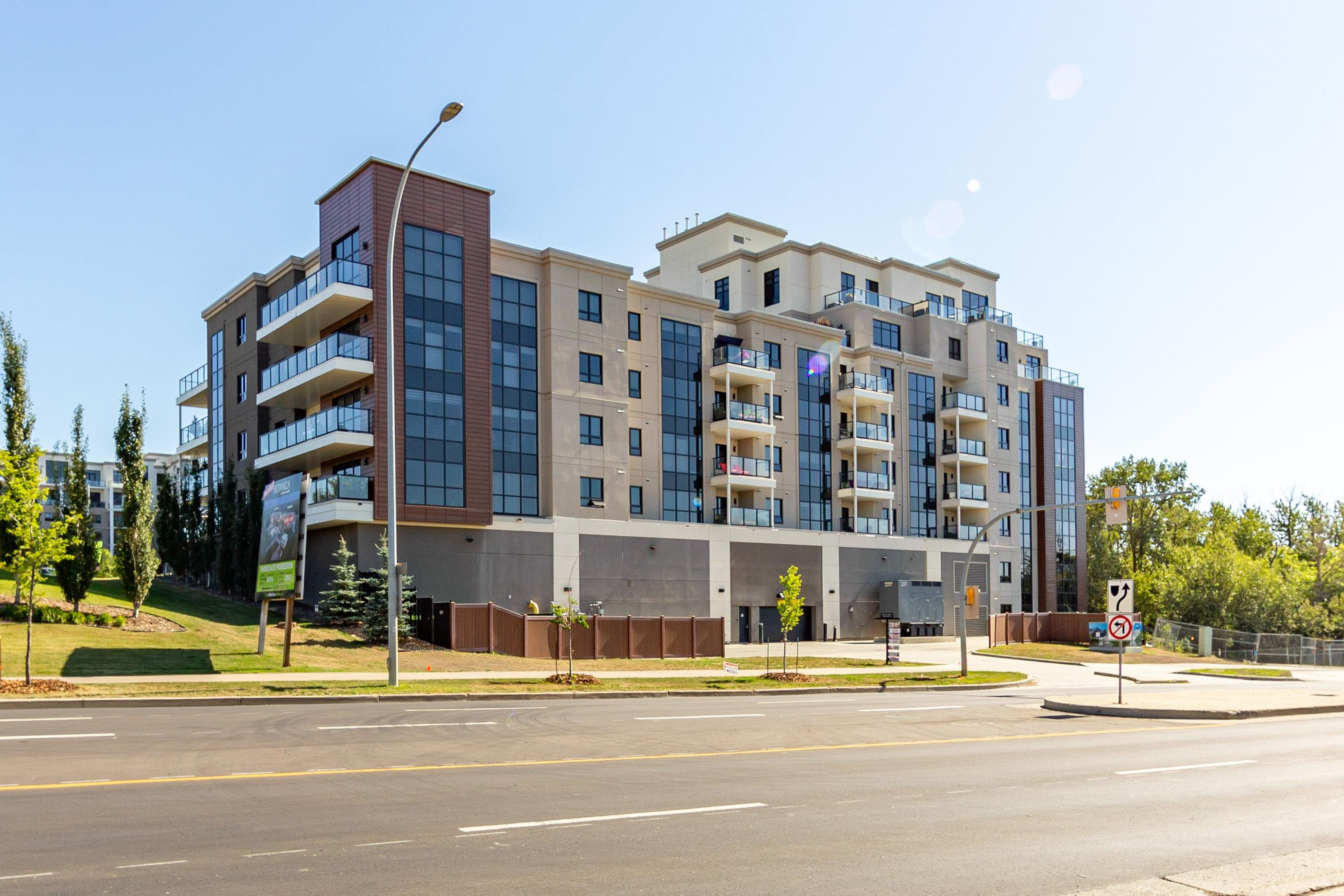 Welcome to beautiful Botanica! Expect to be impressed upon entering this luxurious unit. From the high end kitchen, upgraded lighting, engineered hardwood flooring, custom window blinds,  bbq gas line on patio, cozy living room with tiled electric fireplace feature wall.  The primary suite features a large walk in closet and an upgraded spa like 5 piece ensuite with soaker tub. The second bedroom is a great size with a 3 piece main bathroom. You have your own separate laundry room with stackable washer and dryer and storage space. Title parking stall in underground heated parkade with storage locker. The building provides a high end fitness center, guest suite, luxurious social room, 4000sf rooftop garden terrace. All of this along with being in walking distance to the Sturgeon river, Red Willow Park, The Italian Market, and other convenient amenities. You won't be disappointed!