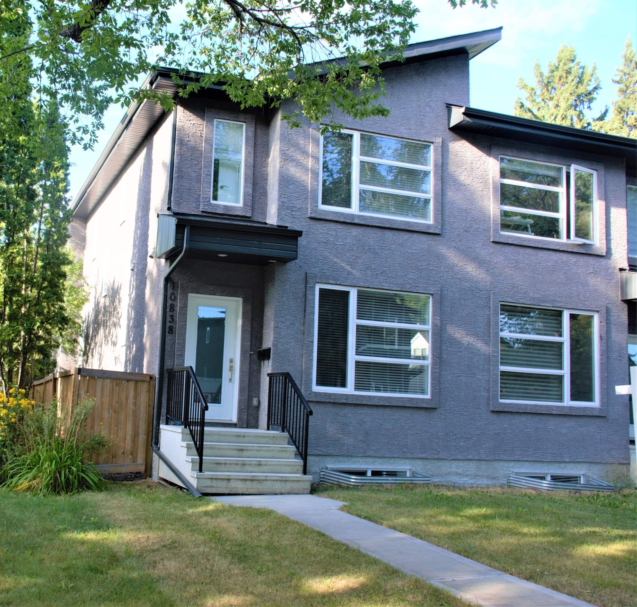Welcome to this half duplex in ALLENDALE! Enjoy everything this mature neighborhood has to offer while living in your half duplex. This property has been completed with hardwood flooring on the main floor with 9 ft ceiling comes with a fireplace, designated dining area, with stylish lighting, pantry & half bath. Upper floor features 3 bedrooms with the Master boasting a 4 pc. en suite; spacious main bath and gorgeous exterior stucco finish. Comes with stainless steel kitchen appliances. Fully finished basement has separate entrance good size bed room large living room full bath and kitchen. To complete this package there will be a double detached garage provided with fence AND landscaping front and back! All of this in an established community & close to downtown and a short drive to the U of A.