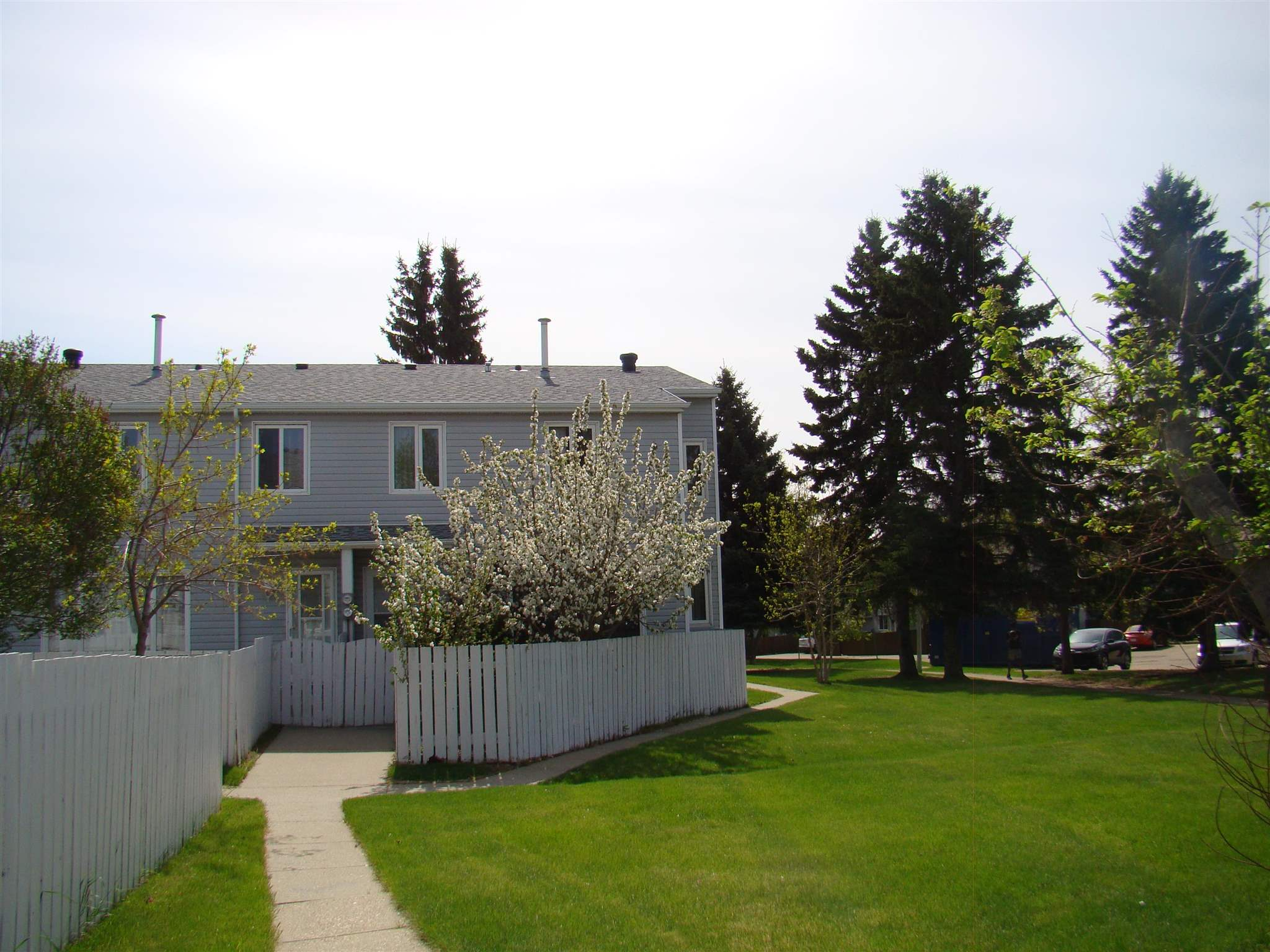 Excellent END UNIT 2- Story condo siding onto a green space!! The main floor features a big living room with loads of natural light coming in from the SW facing picture window, a updated kitchen with lots of cupboard and granite counter top space a, ceramic tile flooring and a dining room with a extra window. The upper level has 3 good size bedrooms, and a full  4piece bath. The basement is fully finished with a large family room, another 4 piece bath plus a laundry/utility room. This unit has a fantastic location with a south west facing back yard that over looks a green space. There is street parking close by as well. The complex is well run and has had may renovations over the years. Low condo fee of $230 a month. Complex is close to many schools, Londonderry mall, public transportation and Clareview rec center. Great for first time buyers or investors.