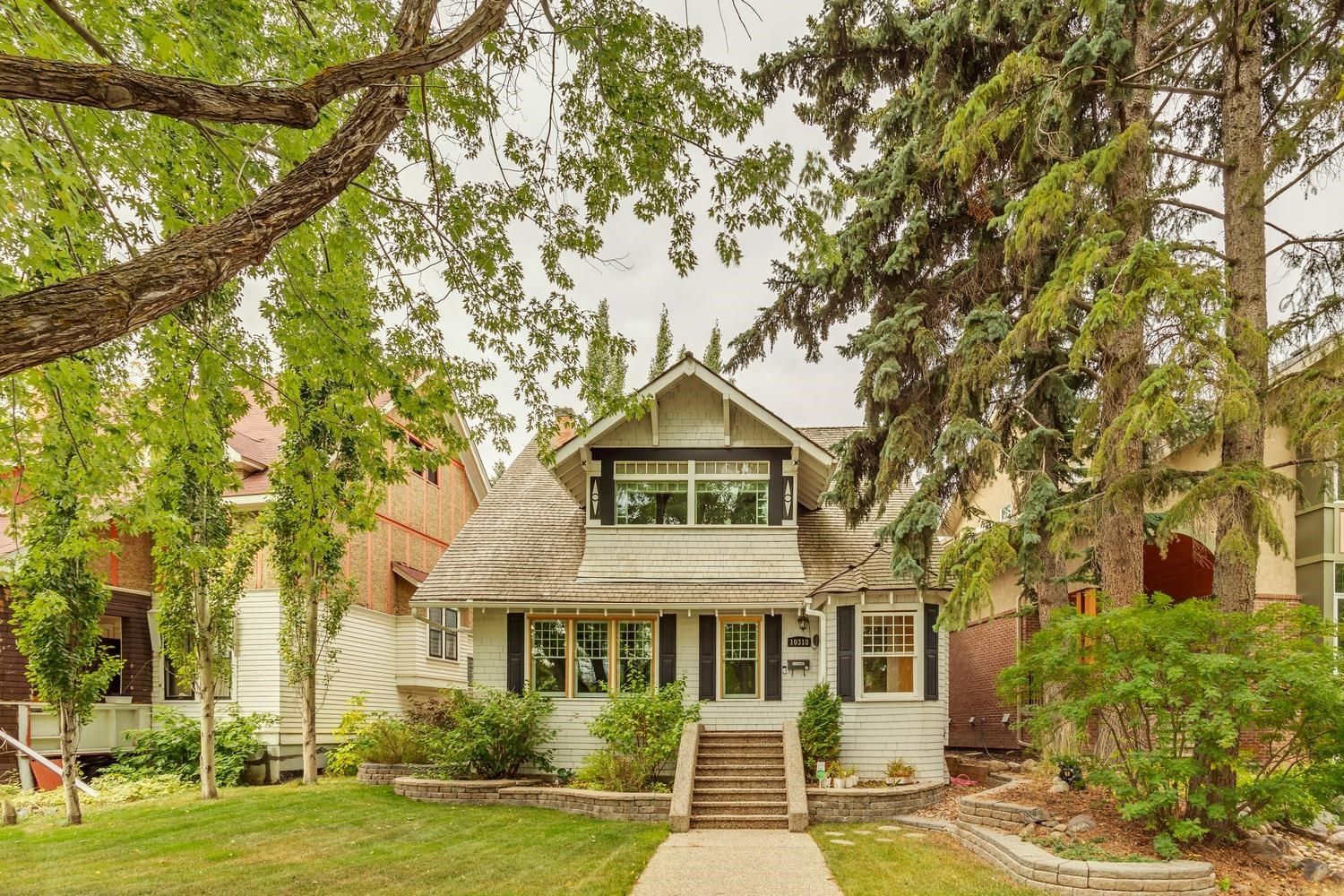 """Magnificent opportunity to live on one of Edmonton's most historic streets. """"The John Sherry Residence"""" was originally designed by architect James Henderson in 1912, and has recently been completely restored while retaining much of its original charm. This 2100+ sqft, 2.5 storey character home offers a stunning mix of distinct architecture and modern decor. The main floor features a beautiful kitchen w/granite counters, premium cabinetry, s.s. appliances, open living area w/stunning fireplace, elegant dining area, and hardwood throughout. On the upper level you will find the huge master suite with a den area, 4-pc ensuite, and plenty of closet space. Large second bedroom, and additional 5-pc bath. The top level offers an open loft/bonus area that could easily be converted to a 3rd bedroom. Recent upgrades include: electrical, mechanical, plumbing, kitchen, bathrooms, flooring, roof, windows, paint, fixtures, double garage, and more. Located steps from the Downtown core, 124th st, and the River Valley."""