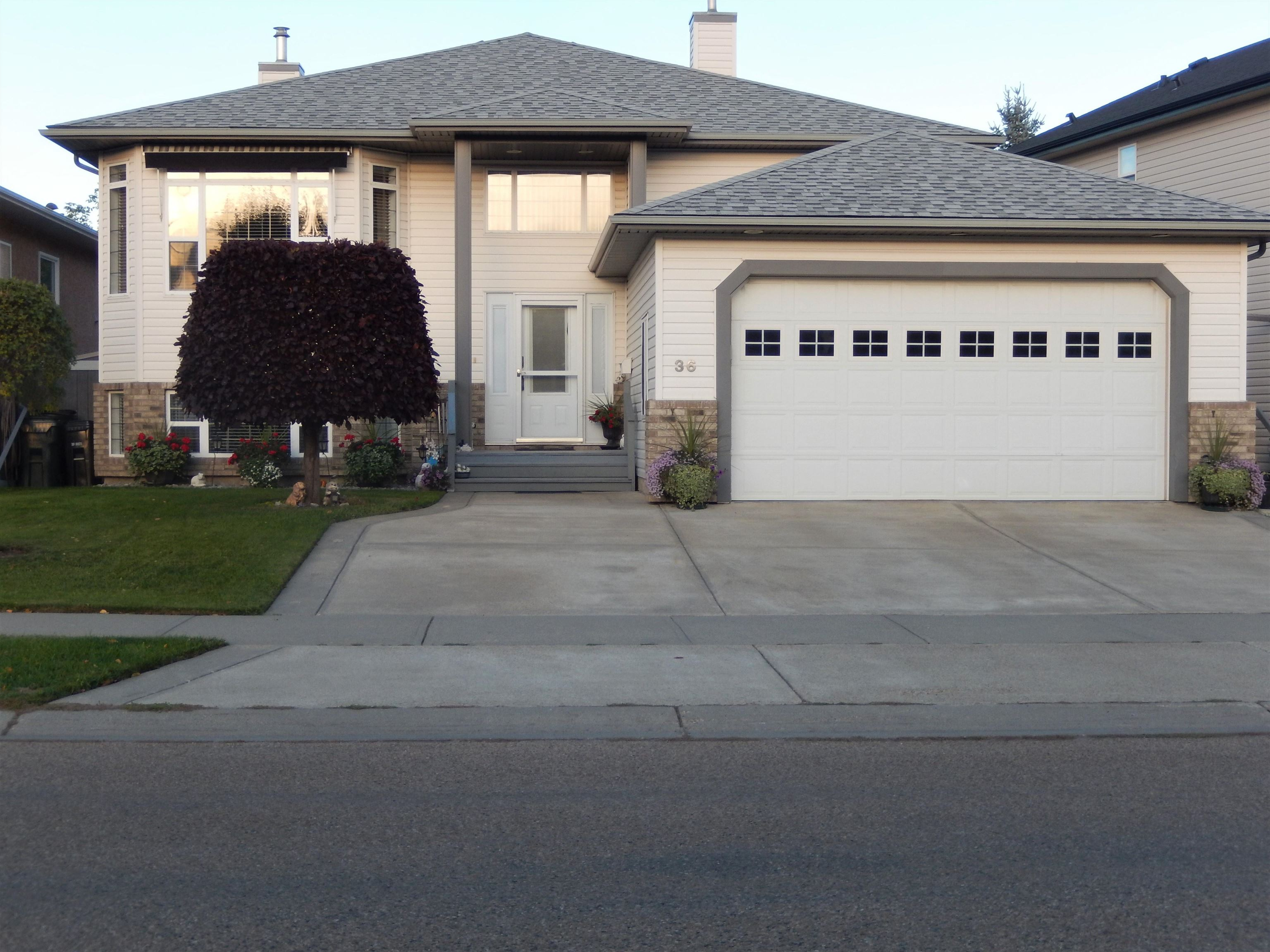 IMPECCABLE HOME with over 2700 sq ft of living space. Its had the same owner for the last 15 yrs. Spacious kitchen with ISLAND/EATING BAR, large PANTRY, built in CABINET/DESK & a spacious dining rm with 2 WAY FIREPLACE thru to the living room. The back door off the kitchen leads out to the DECK for convenient BARBECUES. PILLARS, LARGE BAY WINDOW & unique style finish the living rm. The MASTER BEDR has a WALK-IN CLOSET, & glorious ENSUITE, complete with CORNER JACUZZI, MAKEUP VANITY, separate SHOWER & WATER RM. No carpet on the main or on the stairs. Downstairs....LARGE FAMILY RM with CORNER GAS FIREPLACE,  2 more LARGE BEDRS complete with WALK-IN CLOSETS, FULL BATHR & LAUNDRY RM plus loads of STORAGE AREAS & the UTILITY RM.   SHINGLES were replaced 2 yrs ago & the mother board on the FURNACE (1 YR). The immaculate yard is FULLY FENCED, has a MAINTENANCE FREE SHED, STONE PATHS, SCULPTED TREES + PERENNIALS. The GARAGE (20x23) is RADIANT HEATED & comes with WORKBENCHES, SHELVING & AIR COMPRESSOR.