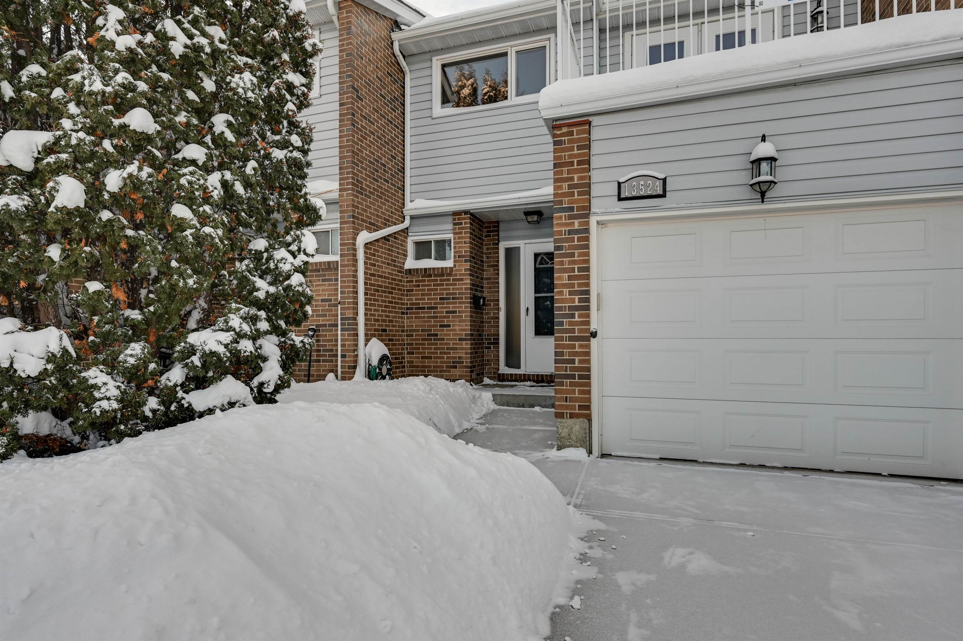 Fully renovated 2 storey townhouse with single attached garage in the community of Belmont. This home offers new laminate flooring and counter tops, newer cabinets, and backsplash in the kitchen. The main level opens up to an inviting and spacious living and dining room area with access to a large fenced private back deck with gas line and gas barbecue. A convenient powder room is located on the main floor just off the front entry. The upper floor has 3 large, upgraded bedrooms and a renovated full bathroom. Enter the primary bedroom through double French doors and retreat to a substantial sized sanctuary with a private east balcony. No need to feel cramped here as the basement features a fully developed family room with a refinished corner stoned wood burning fireplace. Upgrades includes furnace 2020, hot water tank 2019, aluminum to copper conversion 2020 on all sockets and switches, new lighting throughout and new electrical panel 2021 with permit. Simply a splendid home for cocooning or entertaining.