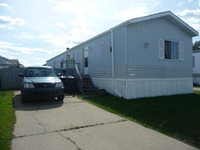 1989 Regent 3 bedroom 2 bathroom 1248sq.ft. mobile home in Lakeland Village. Excellent location with easy and convenient access to all amenities including schools, shopping, restaurants, entertainment, hospital, and the Trans Canada Yellowhead. Features include a nice open concept floor plan with a large kitchen and dining area, oak trim throughout, living room with vaulted ceiling, master bathroom skylight, and 2014 flooring upgrades in the master bedroom and living room. Some further finishing is required. 6 appliances included plus a window air conditioner and storage shed. Priced to sell with quick possession.