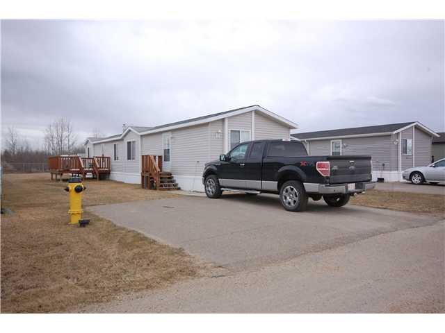 This 3 bedroom & 2 bathroom mobile is located in quiet area in Millet. Over 1200 sqsft, with an island & pantry in kitchen, large laundry/furnace room, Large master with a huge closet & 4 pce ensuite, large living area, 2 nice size second & third bedrooms and another 4 pc bath. 2 large sheds, 10' x 14', all appliances included and a nice large deck. Great for first time buyer!