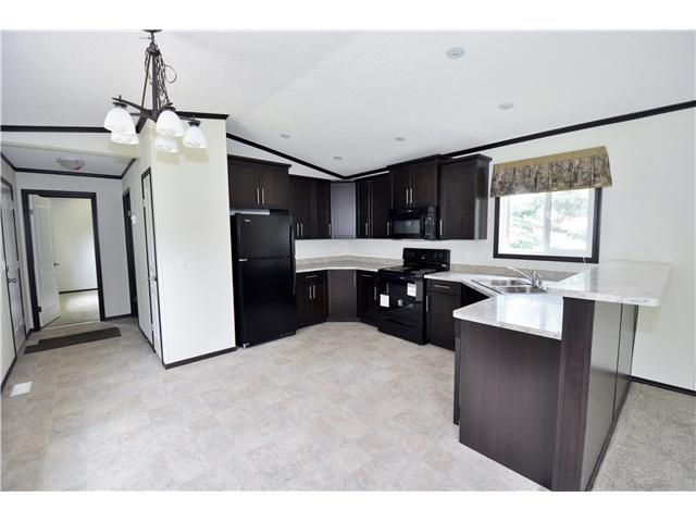 NESTLED IN TREES this 2014 MOBILE PET FREE-CAT FREE HOME SITS ON 1 ACRE OF LAND 10 Min. North of Stony Plain/ Spruce Grove. 14 Min. West of St Albert. ENJOY PEACFUL COUNTRY LIVING~~~~ at this AMAZINLGY LOW PRICE OF $169,000. LOT RENT $460.00 INCLUDES WATER & SEWER !!! AND TAXES ARE A MERE $1400.00. CHEAPER THAN RENT? .... ABSOLUTLEY !!! ENJOY THE BEST EXPENSIVE LIVING TO BE FOUND THIS CLOSE TO CITY LIFE ~~~~ FANTASTIC VALUE ~~~~ BONUS LOCATION? WITHOUT QUESTION ~~~~ RIGHT NEXT DOOR TO 'CALAHOO HILLS' GOLF COURSE & A MERE 2 MILES TO A GENEROUSLY STOCKED GROCERY STORE LOCATED IN THE DELIGHTFUL VILLAGE OF CALAHOO. BONUS FEATURES ARE: VAULTED CEILINGS; 3 BDRMS; 2 FULL BATHS -1 WITH A WONDERFUL OVAL SOAKER TUB; EXPRESSO CABINETRY; SPACIOUS LIVING ROOM & KITCHEN ~~~~ AND MATURE TREES CREATE A CURTAIN OF GREEN TO ENJOY. PRICE INCLUDES - FRIDGE, STOVE & BI DISHWASHER. SKIRTING TO BE INSTALLED PRE POSSESSION. MOVE TO THE COMMUNITY FAMILIES RETURN TO NOW RAISE THEIR CHILDREN. SW 1/4 - 30 - T54 - R27 - W4.