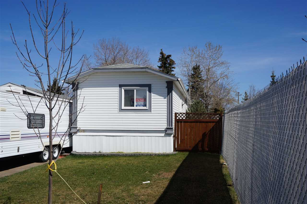 This like new mobile home is situated on a large landscaped  lot and has only one neighbor. The home features 3 bedrooms and the private  master has a 4 piece en-suite with a jetted tub. The super bright kitchen features a vaulted ceiling with a skylight, a corner pantry and a portable island with a raised eating bar. The living room also has a  vaulted ceiling and has like new laminate flooring. the exterior of the home has vinyl siding with pillar accents and a huge 2 tier wood deck. Lot rent is $561 and includes water, sewer and garbage removal.