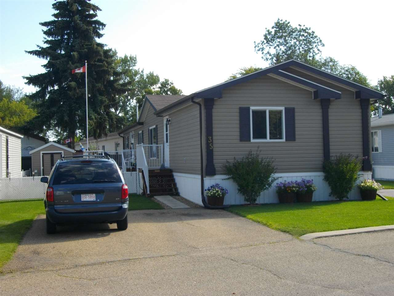 Welcome to this 2011 custom ordered centrally air conditioned modular home featuring an open plan enhanced by a vaulted ceiling.  Entertain guests, relax with a book or watch your favourite program, while sitting beside the cozy fireplace in the Living Room.  Smell those tantalizing aromas wafting out of the Kitchen preceding a great meal with guests.  Stainless steel appliances, a pantry, plenty of cupboards and counter space, as well as an island with pot drawers make this Kitchen a chef's dream.  Be refreshed after a good night's sleep in the Master Bedroom featuring a four piece ensuite with a walk-in shower and a walk-in closet.  One of the two other large Bedrooms can be used as a guest room for visitors, a hobby room, den or an office.  Barbeque on the back deck during those warm summer evenings. A storage shed is ideal for the garden tools and excess storage.  Pick fresh vegetables or strawberries from the small garden or half barrel pots. This home features many upgrades for you to enjoy.