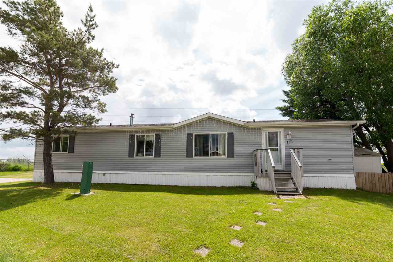 This home is in the perfect location ! Just minutes to Spruce Grove and in a community that offers many amenities such as playgrounds, a community hall, skating rink, school, gas station & store. The home is on a large lot in Parkland arkland Village offering plenty of yard space & a storage shed. The private lot has no neighbors to the east and backs onto a farmers field. With 2 bedrooms & 2 full bathrooms there is lots of room throughout for the family or roommate. The kitchen boasts plenty of cupboard and countertop space leaving you with no lack of storage. The open kitchen & living room floor plan makes it a great space to hang out with family, friends & entertain. The double entrances and washer & dryer area are added benfits in this perfectly designed home.