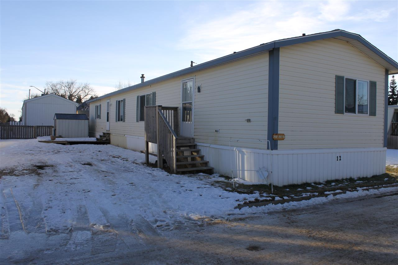 Great value!  This single-wide mobile home located in the growing community of Tofield features a deck, storage shed, several newer appliances, and ample parking space for two vehicles.  With three bedrooms and over 1200 square feet of space to work with, this home is ideal for a young couple or small family, or for those looking to down size.  Welcome home!