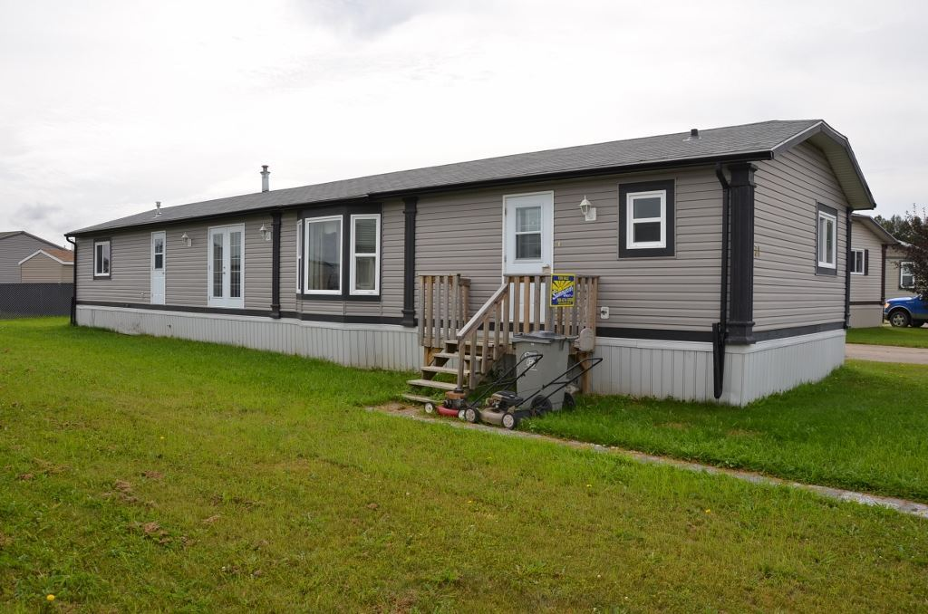 2008 Triple M Housing 20' Wide 1520sq ft Modular style Home on leased lot at 31 Keystone Place in Whitecourt, AB. Good open floor plan kitchen, dining and living room combo featuring vaulted ceilings, central kitchen island, white cabinetry and corner pantry. 3 spacious bedrooms plus 2 full baths. Conveniently large laundry room with space for deepfreeze. This is a Modern well built home ready and awaiting a little bit of your own personal restyle and design in a package you can afford.