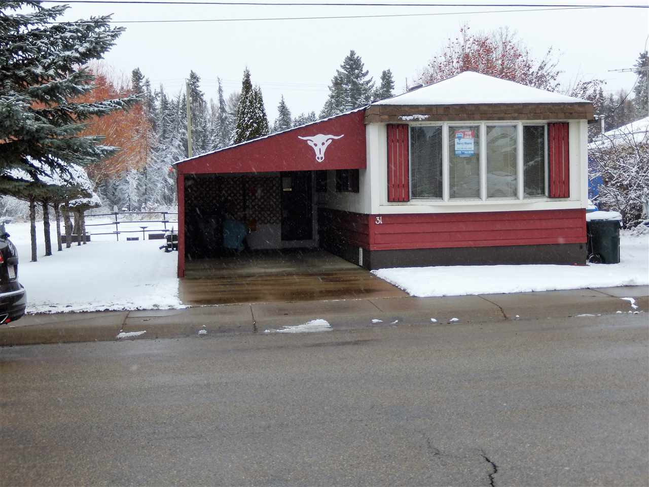 EXTEMELY WELL CARED FOR HOME BACKING ONTO GREENSPACE!!  This home has been loved and it shows!  The ATTACHED CARPORT is nicely finished & is a good size (11x22 deep).  Behind that is the PORCH (11 x 13 ft) unheated.....it serves as a great sitting room in the warmer weather.  The home has 3 bedrs & a spacious bathroom.  The kitchen has an ajoining LAUNDRY ROOM with STORAGE & PANTRY ....DINING AREA has BUILT IN CUPBOARD and the LIVING ROOM sits at the front of the home with a BIG FRONT WINDOW for lots of natural light.  Recent upgrades include the FURNACE with CENTRAL AIR CONDITIONING in 2012; SHINGLES 2016; ALL FLOORING 2014.  The YARD has wonderful MANICURED TREES, GARDEN PLOT, SHED & a small deck off the back door.  PRIVACY is obvious cause it all backs onto an open greenspace and the BIKING/WALKING TRAIL SYSTEM behind that.  Mobile City is a great place to live and it is walking distance to many amenities.