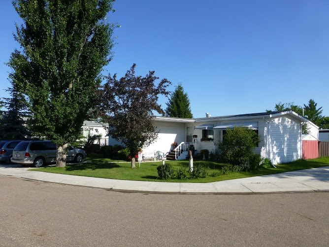 1985 built manufactured home in the Adalca mobile home park. 2 bedrooms 1.5 baths, fenced back yard with garden shed and enclosed deck. situated on a double lot! Excellent value!
