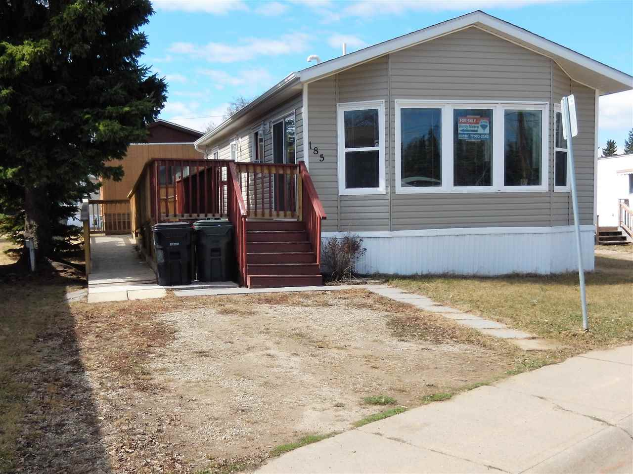 JUST LIKE NEW!!  This 20 WIDE home has barely been lived in and offers a super cool pad for a single person, couple, or even a small family....it would be especially good for someone with DISABILITITIES as it offers a PRESSURE TREATED RAMP, SPACIOUS MASTR BEDR & BATHROOM! There is a PATIO DOOR that leads onto the deck and the MAIN DOOR is wide enough for a Wheel Chair Scooter. The GORGEOUS KITCHEN has a RAISED EATING BAR, 4 BLACK APPLIANCES & tons of COUNTER SPACE!  There is also a DEN that could serve as a second bedroom. The SPACIOUS LIVING RM with BIG BAY WINDOWS sits at the front overlooking the street.  The home is right on Weston Drive on the edge of the park, so it doesn't  feel like you are in a park.  Mobile City is walking distance to a great many amenities including the walking/biking trails system.