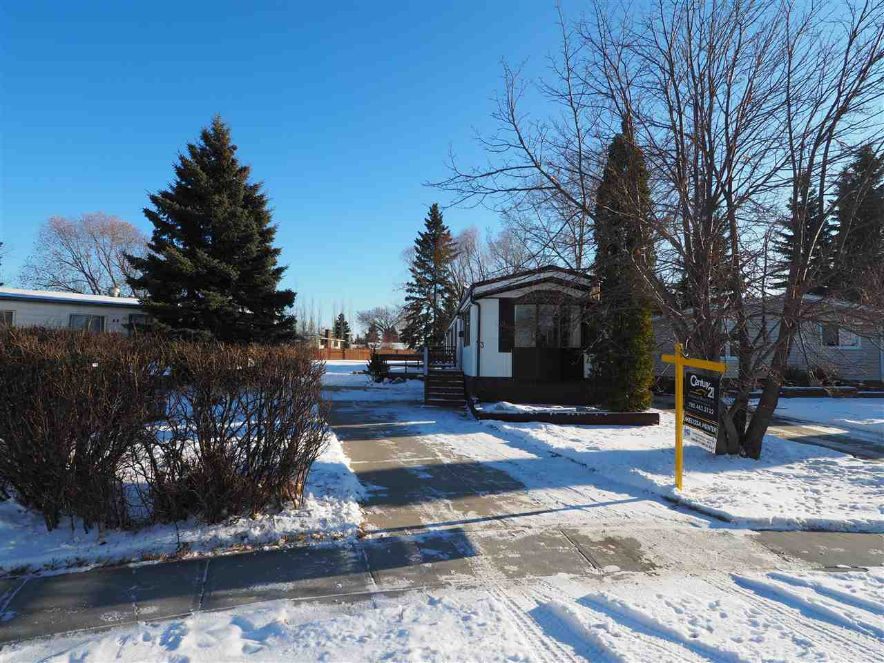 Located in the beautifully kept mobile home park of Castleview Village. This quiet cul de sac single wide mobile backs on to a beautiful green space that leads you right into the Orval Allen Park. The lot features a huge deck, firepit, 4 car parking pad & a HUGE workshop/shed. Inside the home you will be welcomed with a bright open concept. This once three bedroom home has been converted into a one bedroom + flex space. The two small bedrooms have been opened up to allow a bright large space that could be used as an office, TV room or could also be easily converted back into a two or three bedroom home. This home shows pride of ownership around every corner!